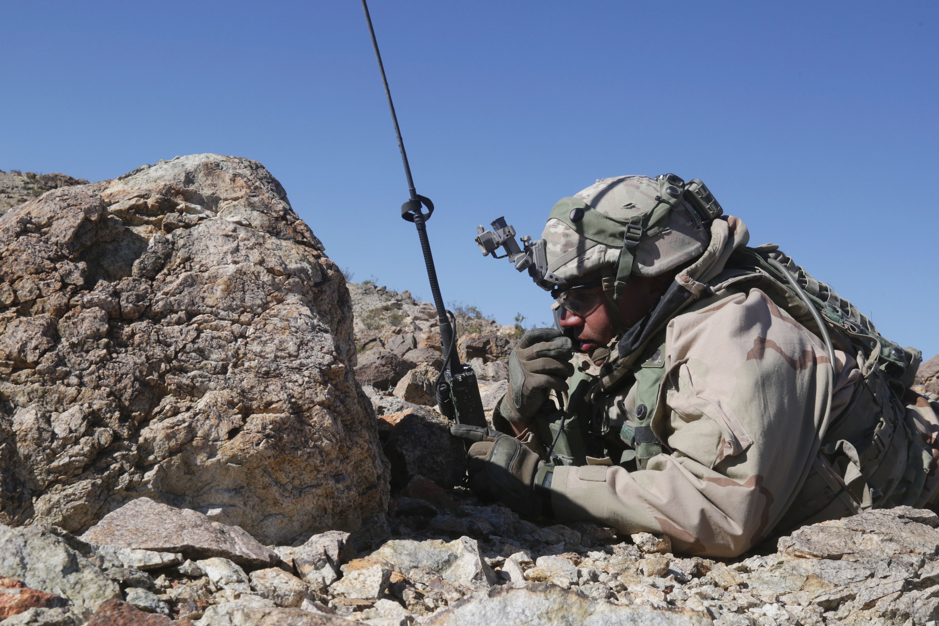 A U.S. Soldier assigned to 3rd Squadron, 3rd Cavalry Regiment, reports enemy positions during Decisive Action Rotation 18-04 at the National Training Center in Fort Irwin, Calif., Feb. 17, 2018. (Spc. Daniel Parrott / U.S. Army)