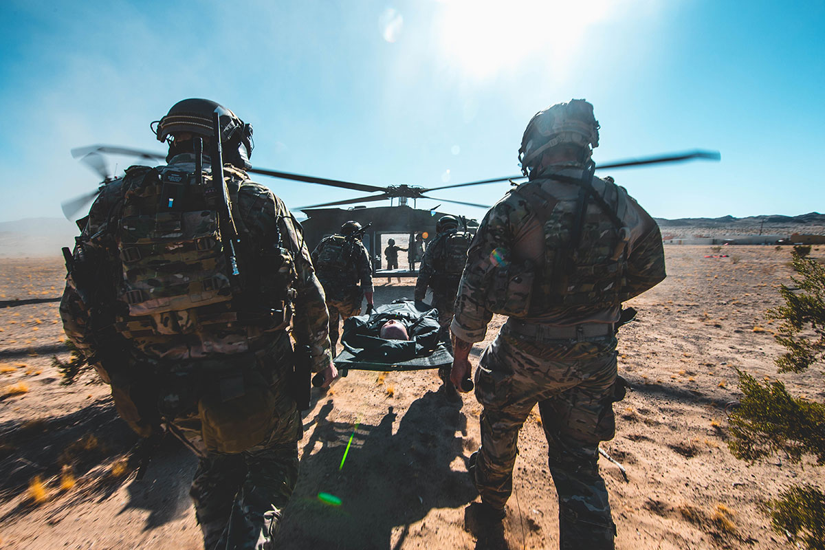 Special Operations soldiers with 3rd Special Forces Group (Airborne) load a simulated casualty onto a UH-60 Black Hawk at Marine Corps Air Ground Combat Center, Twentynine Palms, Calif., Oct. 21, 2019. (Cpl. William Chockey/Marine Corps)