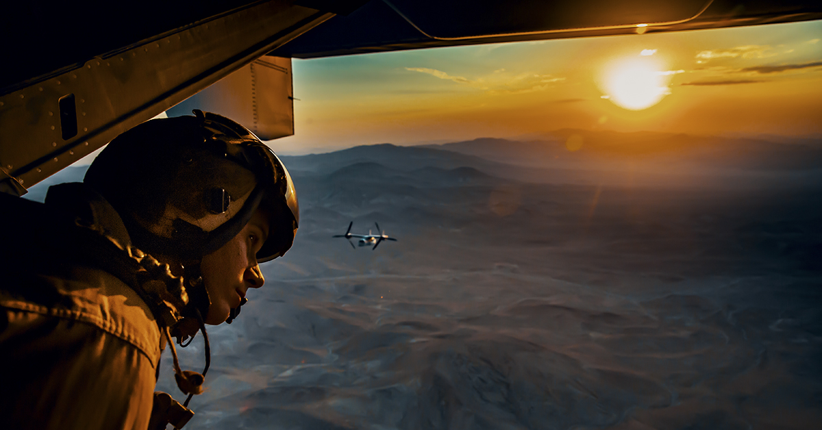"Sgt. Derek Levi, MV22 crew chief, Marine Medium Tilt Rotor Squadron, Marine Aircraft Group 16, 3rd Marine Aircraft Wing looks over the landscape of Marine Corps Air Ground Combat Center, Twentynine Palms, Calif., during an aerial flight formation exercise August 12, 2018. ""I get to see the world from the sky,"" said Sgt. Derek Levi, MV22 crew chief, Marine Medium Tilt Rotor Squadron, Marine Aircraft Group 16, 3rd Marine Aircraft Wing. (Lance Cpl. Rachel K. Young/Marine Corps)"