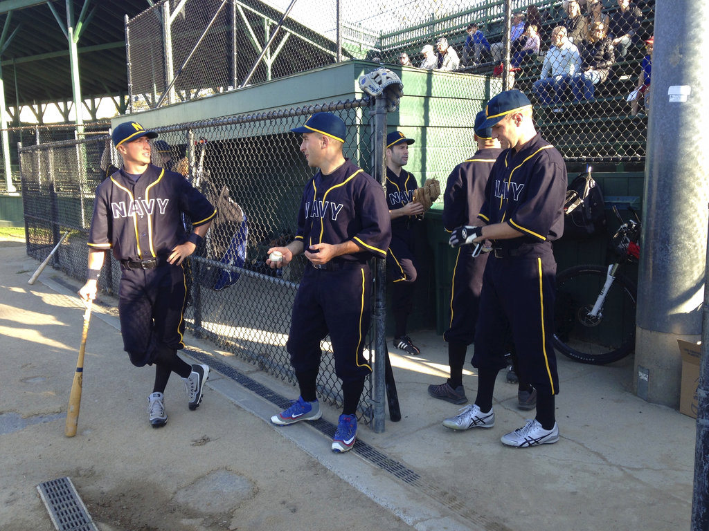 U.S. Naval War College students playing for the Navy team get ready for an Army versus Navy baseball game Friday, Sept. 29, 2017, in Newport, R.I. (Jennifer McDermott/AP)