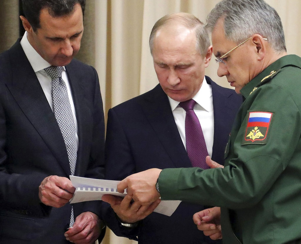 Putin and Assad meet as Russia plans to scale back military presence in Syria