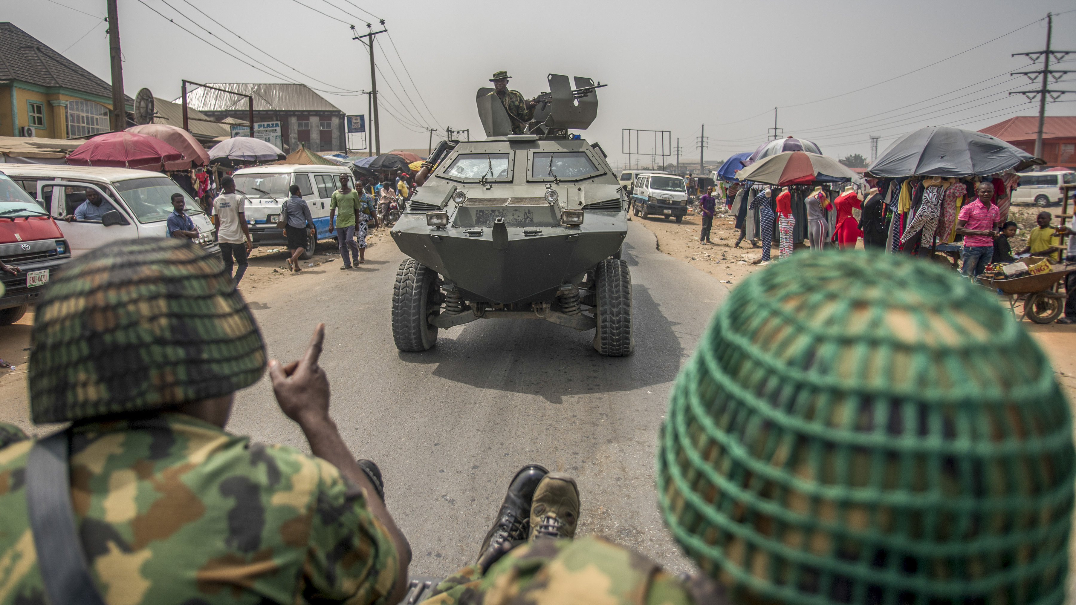 Nigerian soldiers and military convoy drive in Aba, in a pro-Biafra separatists zone, southeastern Nigeria, on February 15, 2019 during a military patrol. - The southeastern Nigeria region, that has long complained it has been marginalized by successive governments and military regimes since the end of the civil war in 1970, has been largely calm in the run-up to the election, but there has been a noticeable increase in military and police checkpoints, AFP correspondents said. (CRISTINA ALDEHUELA/AFP/Getty Images)