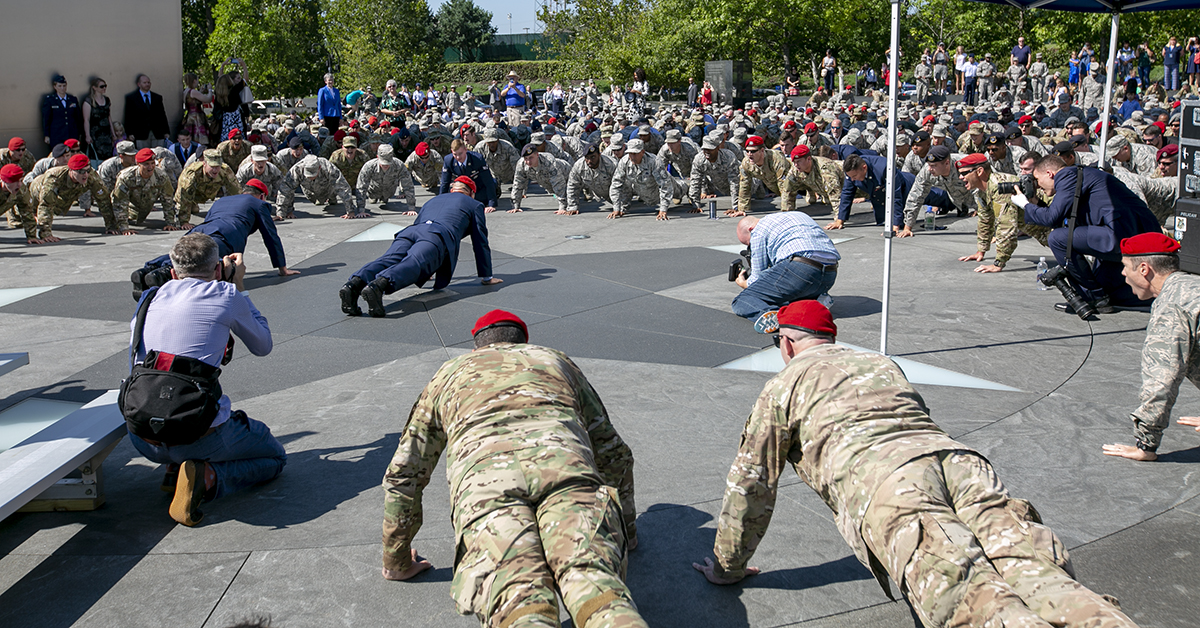 Hundreds of Airmen did pushups in honor of Air Force combat controller Technical Sgt. John Chapman after a Medal of Honor unveiling ceremony at the Air Force Memorial. Chapman, who was posthumously awarded the Medal of Honor Wednesday. (Alan Lessig/Staff)