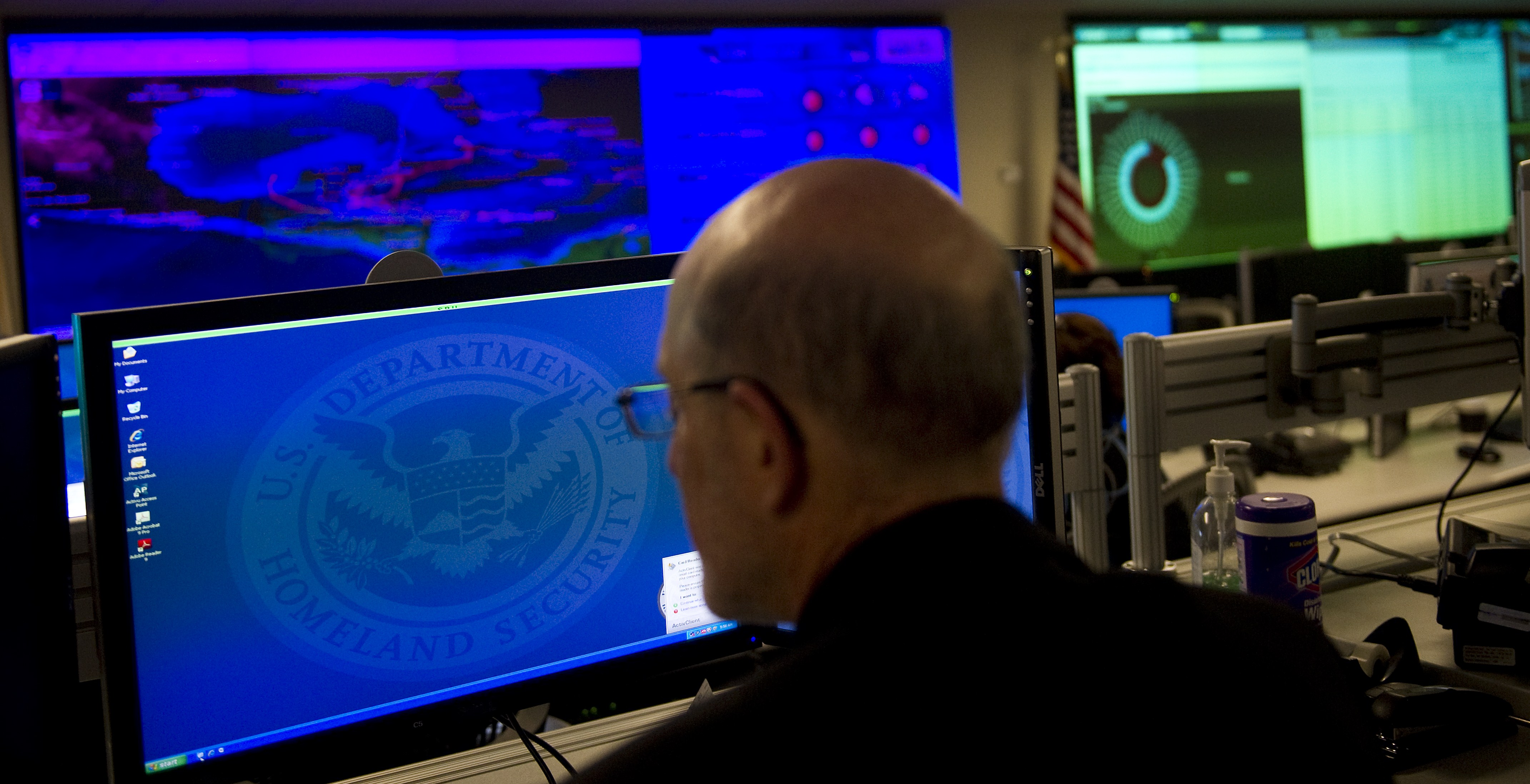 Analyists at the National Cybersecurity & Communications Integration Center (NCCIC) prepare for Cyber Storm III during a media session at their headquarters in Arlington, VA, September 24, 2010. (Photo credit: Jim Watson/AFP)
