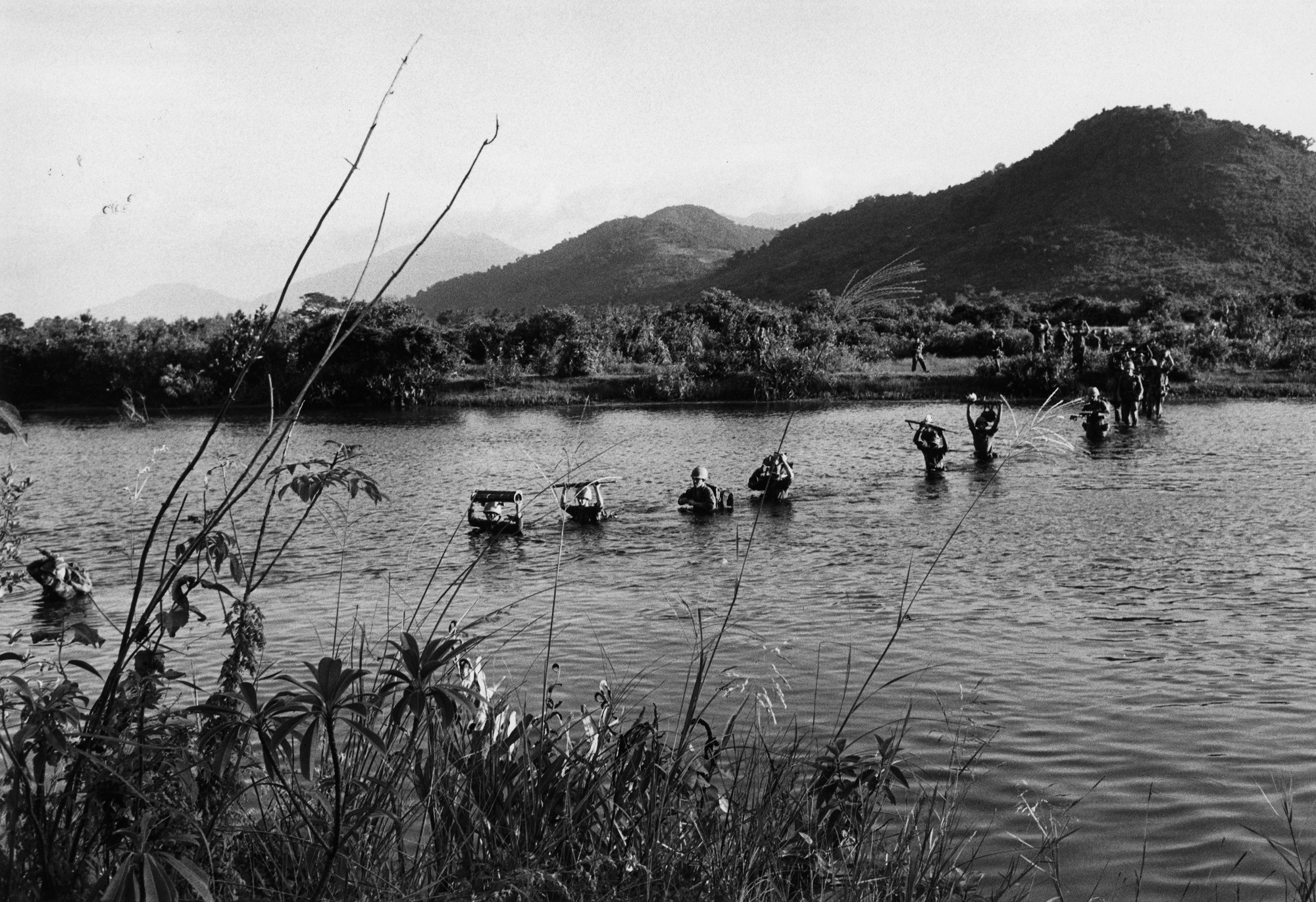 Marines wade across a river near Da Nang, ca. 1965. (Wisconsin Historical Images 75425)
