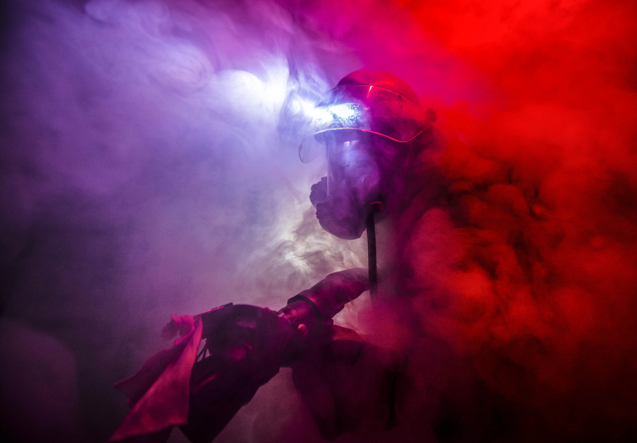 Damage Controlman Fireman James Moore fights a simulated fire during a drill aboard the Arleigh Burke-class guided-missile destroyer USS Porter (DDG 78) in the North Sea, Feb. 4, 2019. (Mass Communication Specialist 2nd Class James R. Turner/Navy)