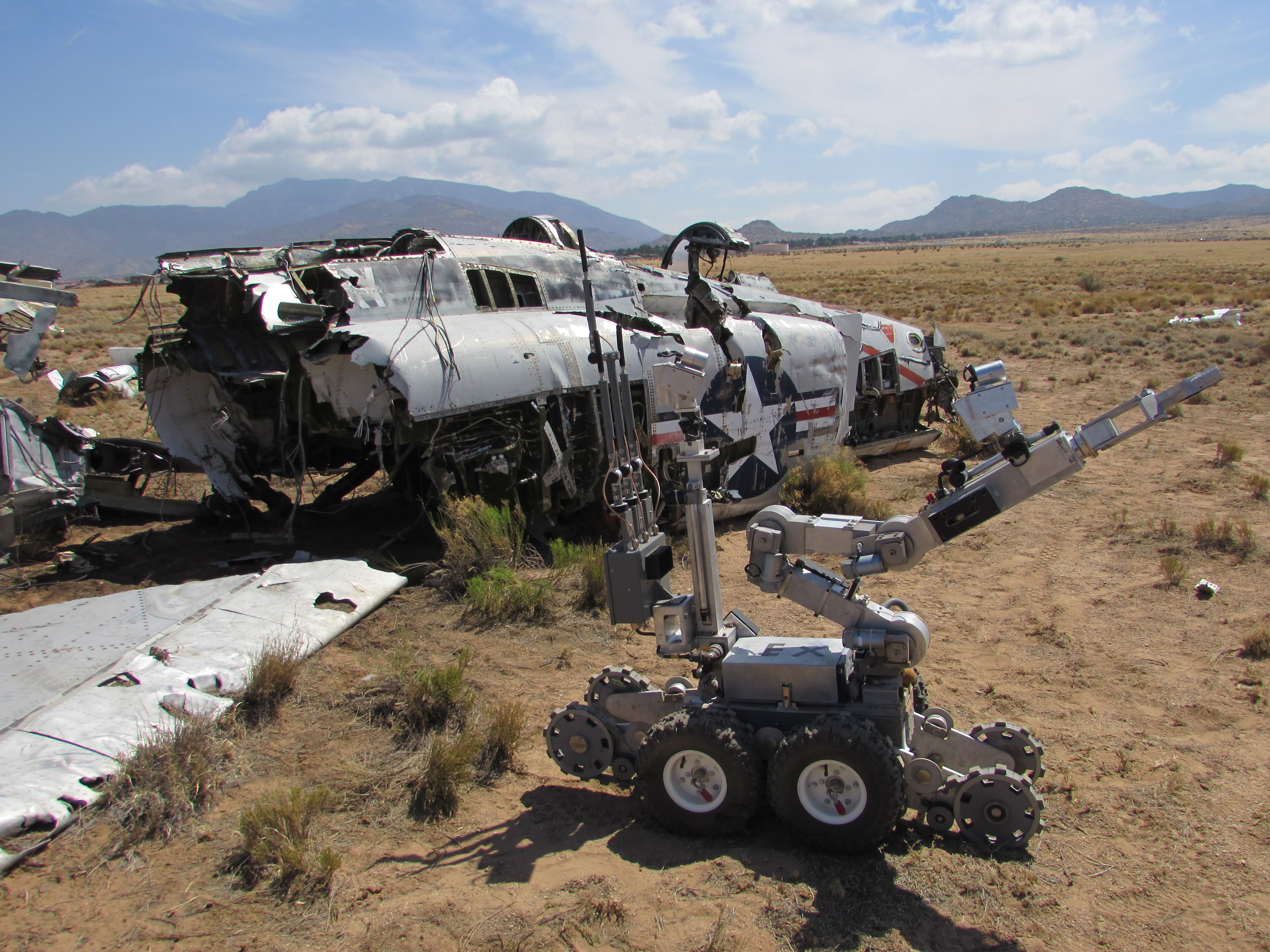 After exploring the simulated crash site, this robot looks for possible objectives hidden elsewhere in the vicinity. (Kelsey D. Atherton)