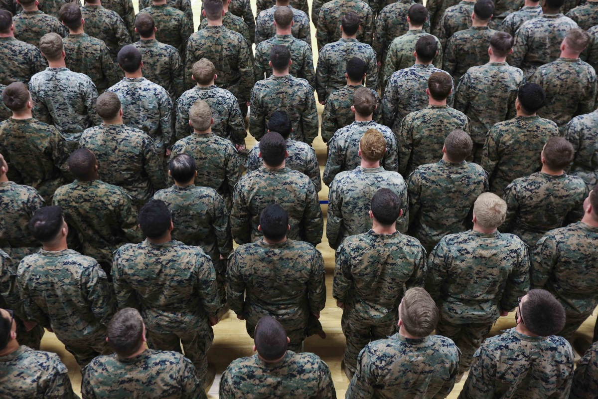 Marines and sailors with Special Purpose Marine Air-Ground Task Force stand at attention before Commandant of the Marine Corps Gen. Robert B. Neller speaks in Sigonella, Italy, Dec. 25, 2018. (Sgt. Olivia G. Ortiz/Marine Corps)