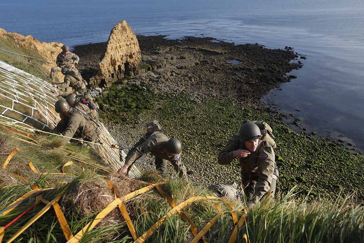 Soldiers from the U.S. 75th Ranger Regiment, in period dress, climb the cliff of Pointe-du-Hoc in Cricqueville-en-Bessin, Normandy, France, Wednesday, June 5, 2019. During the American assault of Omaha and Utah beaches on June 6, 1944, U.S. Army Rangers scaled the 100-foot cliffs to seize German artillery pieces that could have fired on the American landing troops. (Thibault Camus/AP)
