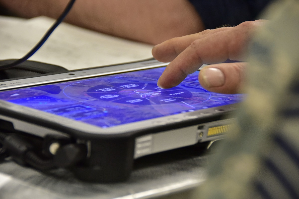 A member of 163d Attack Wing tries out a tablet-based interface designed to control the UTAPP-22 unmanned tactical aircraft on March 17, 2017. The project was part of a DIUx contract to develop the interface. (Airman Michelle J. Ulber/Air National Guard)