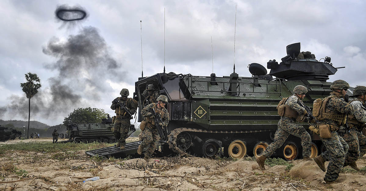 US Marines disembark from amphibious assault vehicles during the joint Cobra Gold exercise in the coastal Thai province of Rayong on February 28, 2020. (LILLIAN SUWANRUMPHA/AFP via Getty Images)