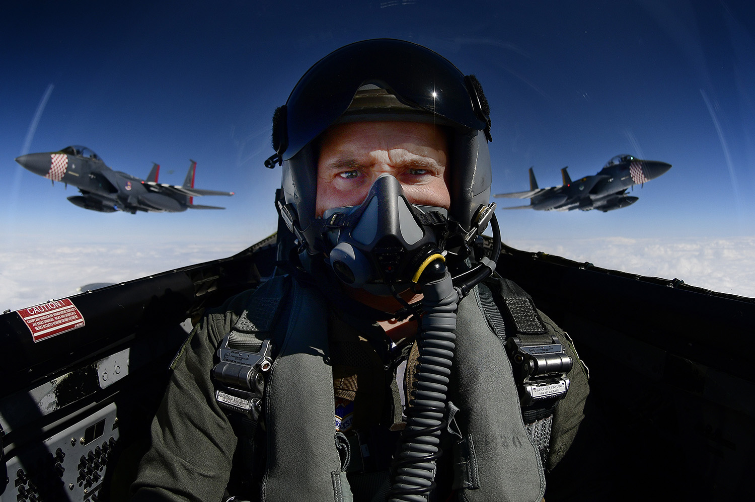 Tech. Sgt. Matthew Plew, 48th Fighter Wing Public Affairs photojournalist, takes a selfie while documenting two F-15E Strike Eagles and an F-15C Eagle conducting aerial maneuvers over southern England, Sept. 3, 2019. (Tech. Sgt. Matthew Plew/Air Force)