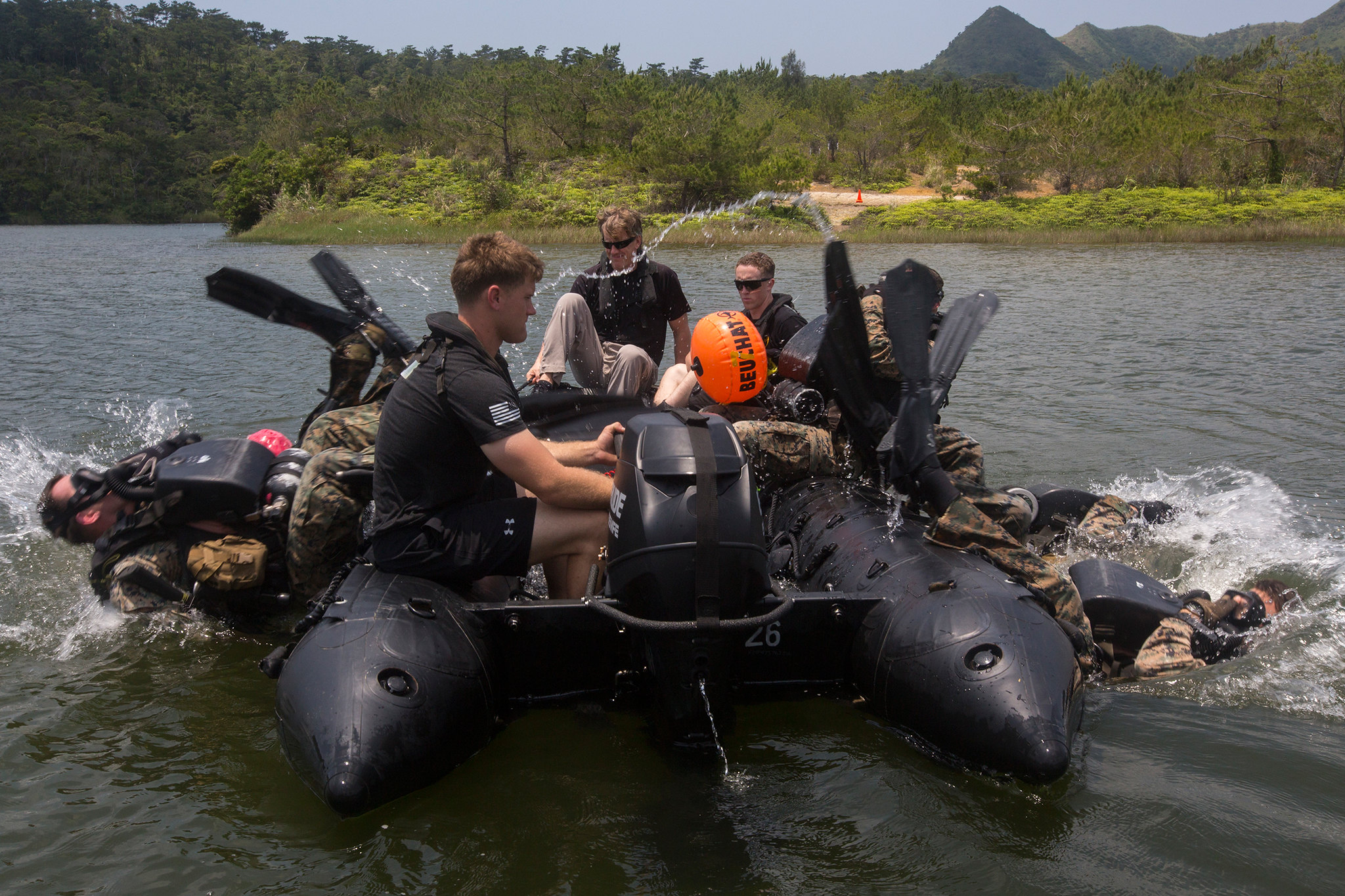 Reconnaissance Marines roll backward into the water during training at Camp Hansen, Okinawa, Japan, May 13, 2019. (Lance Cpl. Cameron E. Parks/Marine Corps)