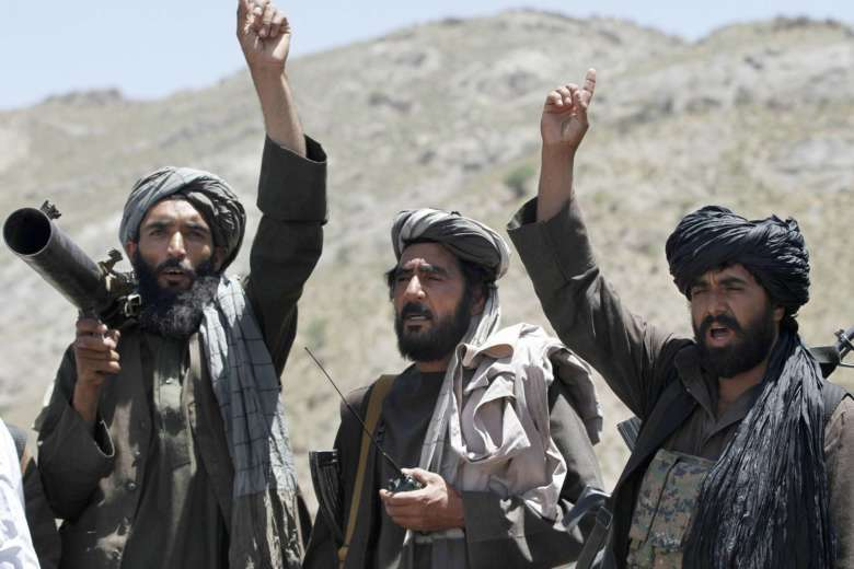 In this May 27, 2016 file photo, Taliban fighters react to a speech by their senior leader in the Shindand district of Herat province, Afghanistan. (AP Photos/Allauddin Khan, File)