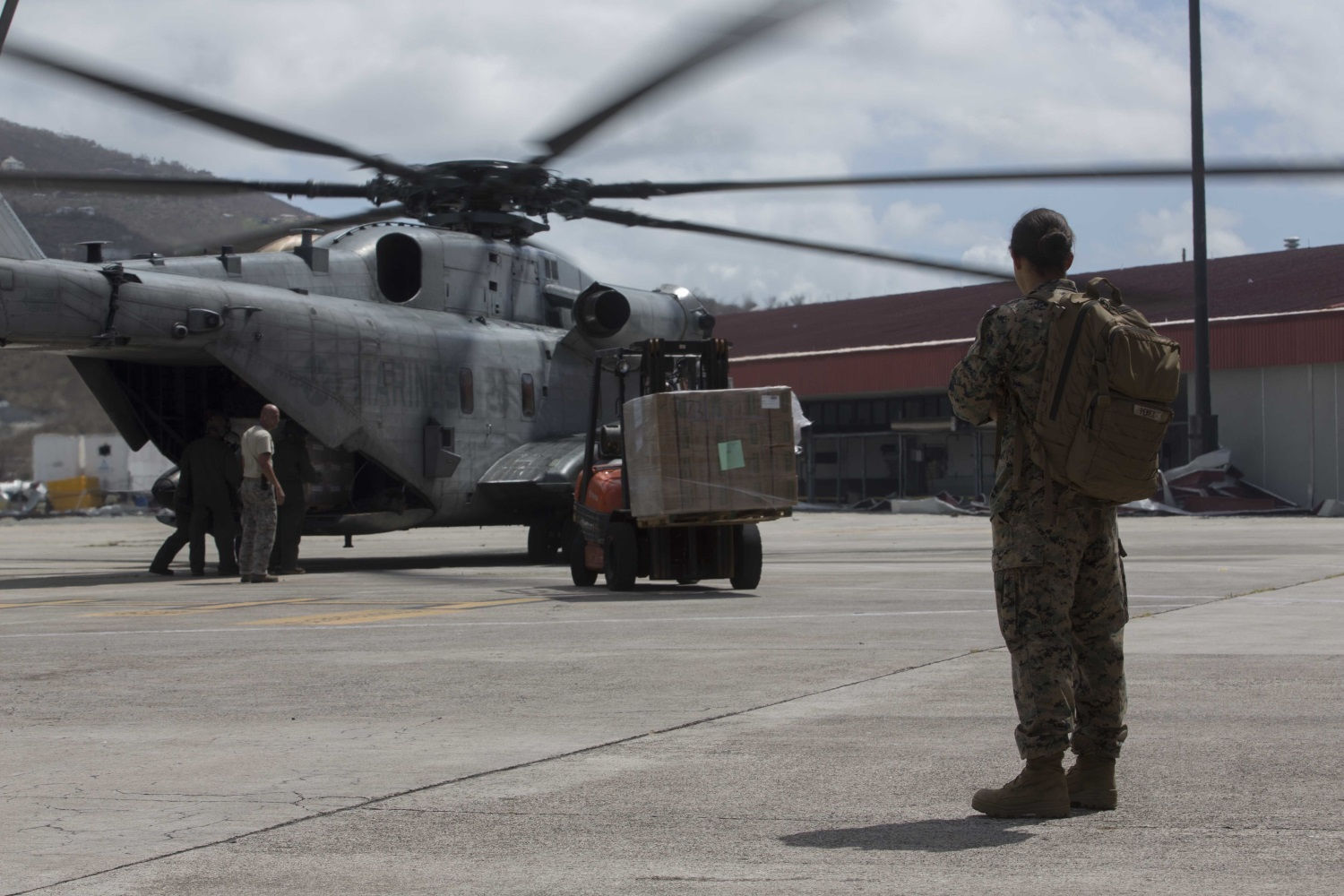 U.S. Marine Corps 1st Lt. Paloma D. Perezurena, a logistics officer with the 26th Marine Expeditionary Unit (MEU), observes U.S. Marines and U.S. Airmen unload humanitarian resources from a CH-53 Super Stallion helicopter with the 26th MEU, to support relief efforts in St. Thomas, U.S. Virgin Islands, Sep. 10, 2017. (Lance Cpl. Santino D. Martinez/Marine Corps)