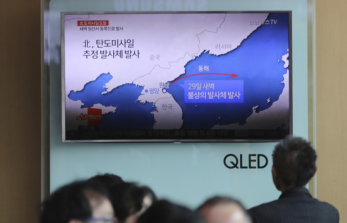 People sit in front of a TV showing reporting about North Korea's missile firing of a short-range Scud missile variant, known as KN-18. It demonstrated a new maneuvering capability for North Korea. The missile's first test is thought to be a success, flying 450 kilometers before landing in the Sea of Japan. (Lee Jin-man/AP)