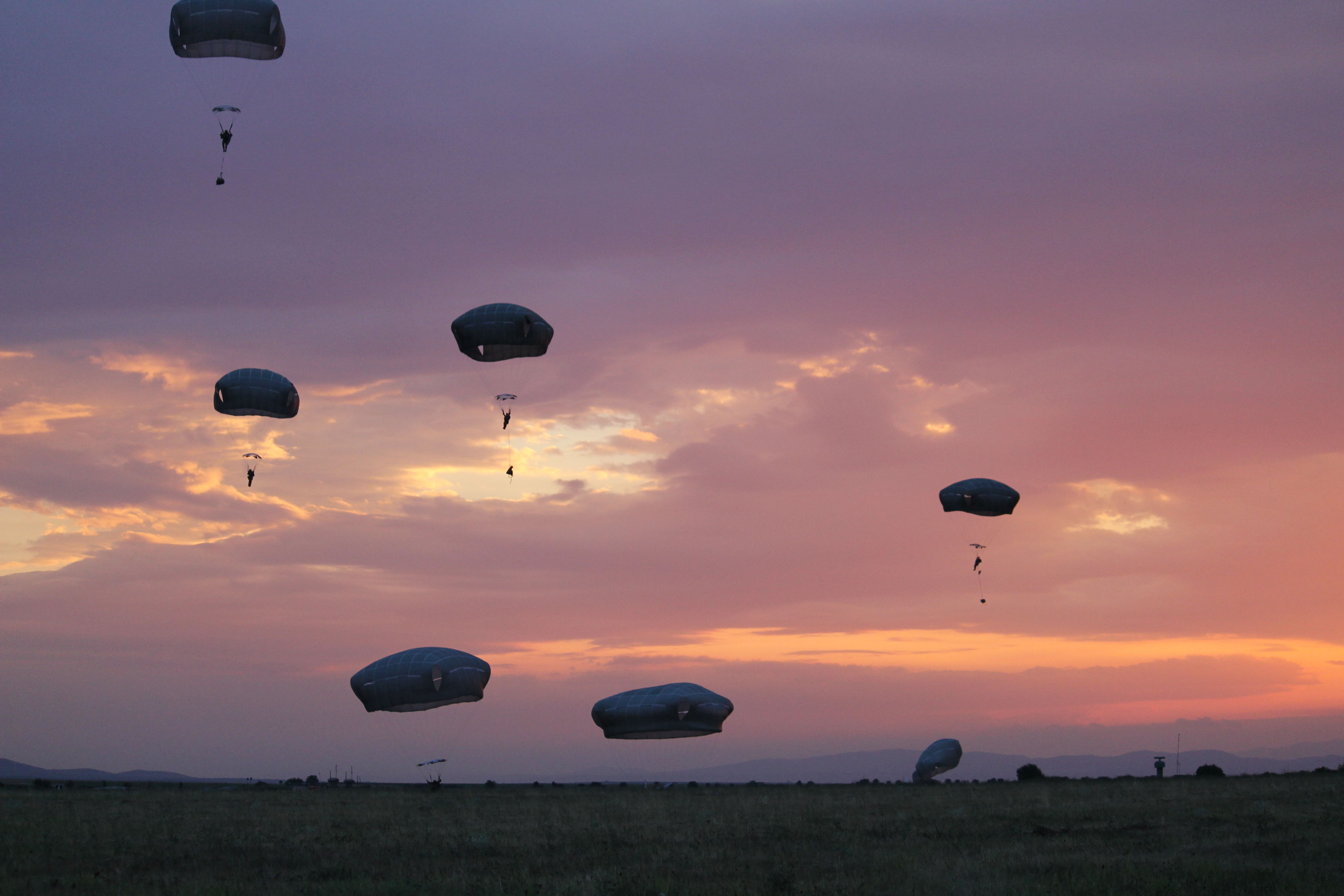 Paratroopers at Swift Response viewed a stunning sunset at Bezmer Air Base, Bulgaria, as the backdrop for their jump. (Jen Judson/Staff)