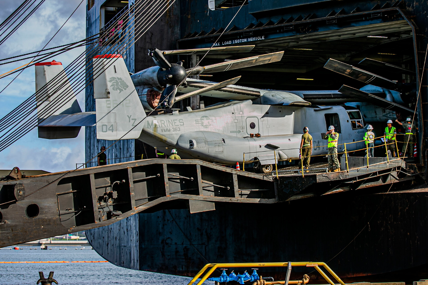 Marines offload an MV-22 Osprey from a vehicle carrier vessel on Joint Base Pearl Habor-Hickam, Hawaii, on Oct. 4, 2019, following a six-month deployment as part of Marine Rotational Force-Darwin. (Lance Cpl. Jacob Wilson/Marine Corps)