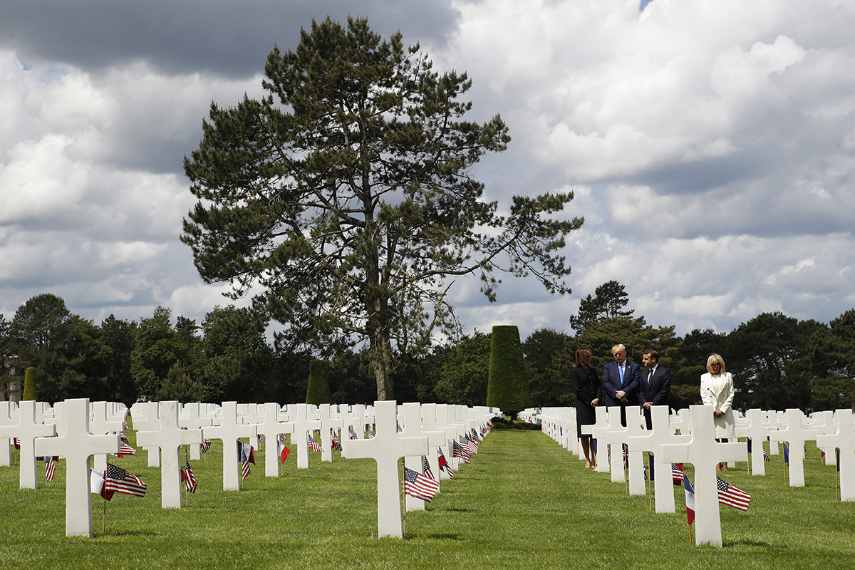 President Donald Trump, first lady Melania Trump, French President Emmanuel Macron and Brigitte Macron, walk through The Normandy American Cemetery, following a ceremony to commemorate the 75th anniversary of D-Day, Thursday, June 6, 2019, in Colleville-sur-Mer, Normandy, France. (Alex Brandon/AP)