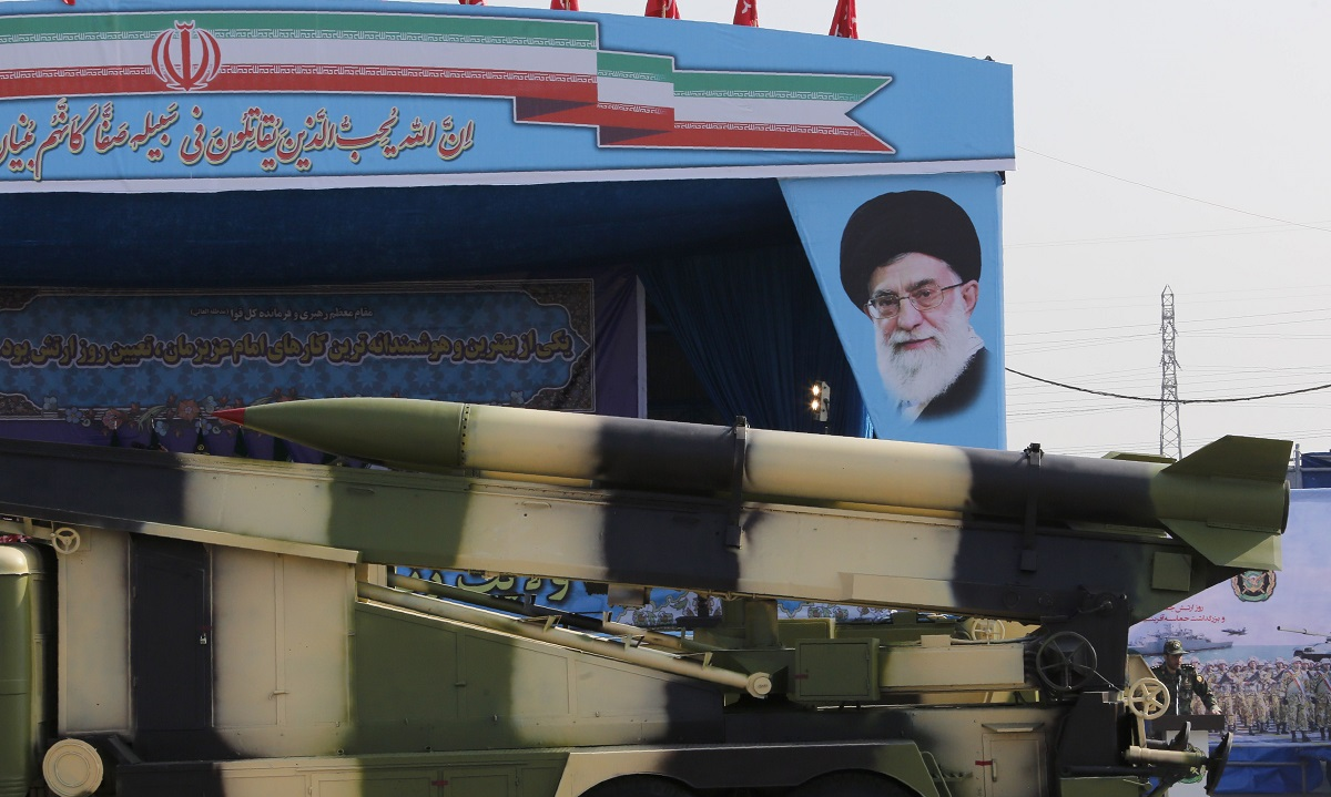 An Iranian military truck carries a Naze'at rocket artillery piece past a portrait of Iran's Supreme Leader Ayatollah Ali Khamenei during a parade on April 18, 2018 in Tehran. (Atta Kenare/AFP via Getty Images)