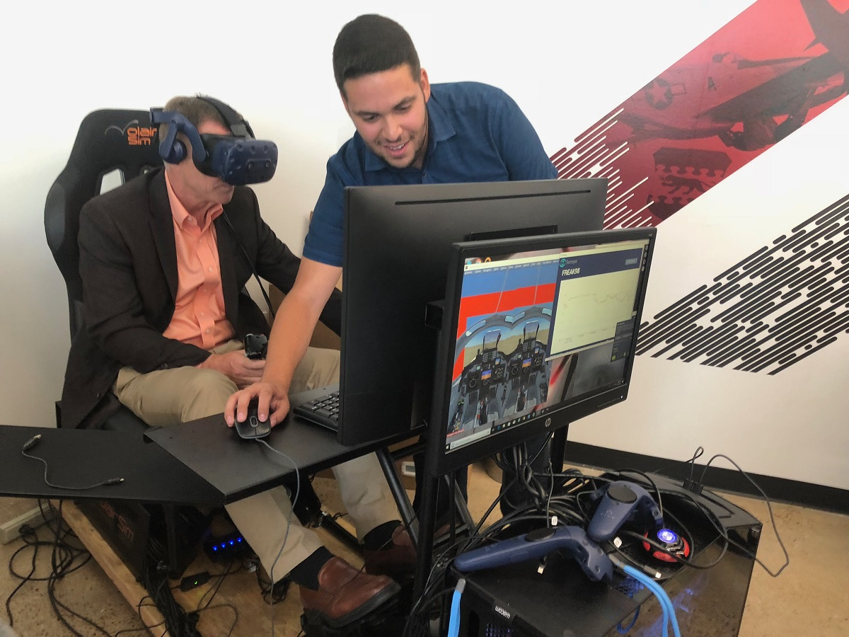 David Zakariaie of Senseye shows Army Vice Chief of Staff Gen. James McConville the ropes in a fixed-wing training simulator at the Capital Factory Aug. 23, 2018. The simulator can determine if he's learned a task by tracking specific eye movements. The technology was developed by Zakariaie. (Photo by Jen Judson/Defense News staff)
