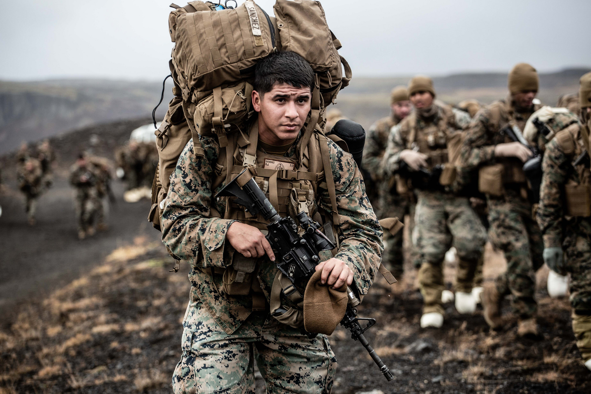 A Marine with the 24th Marine Expeditionary Unit carries cold weather equipment as he begins to march across the Icelandic terrain Oct. 19, 2018. The 24th MEU was in Iceland preparing for NATO Exercise Trident Juncture 2018. (Capt. Kylee Ashton/Air Force)
