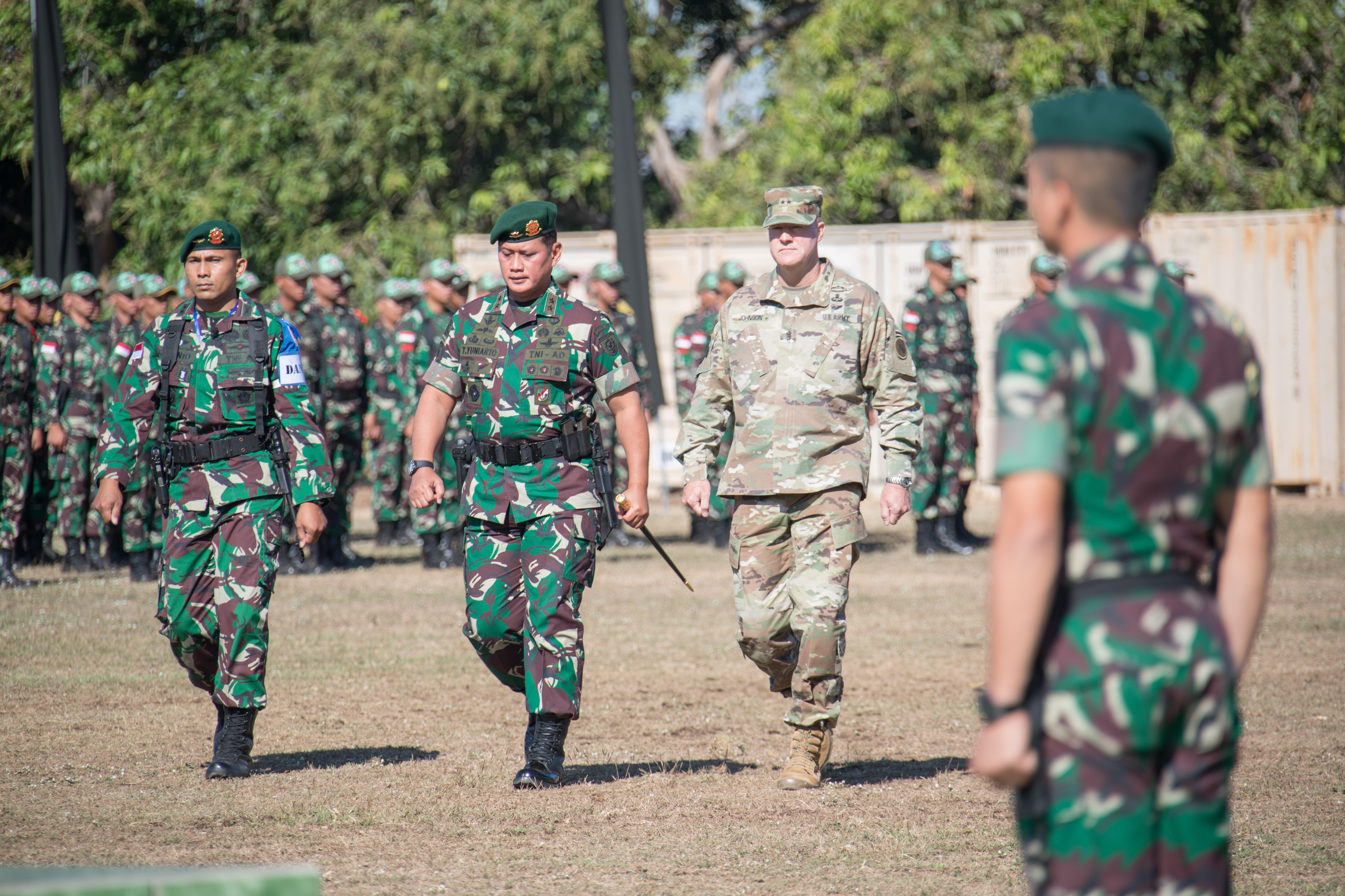 Indonesian Army Maj. Gen. Tri Yuniarto and then-Maj. Gen. Pete Johnson walk through a formation of U.S. and Indonesian forces during the 2019 Garuda Shield opening ceremony Aug. 19, 2019, at Dodiklatpur, Indonesia. (U.S. Army)