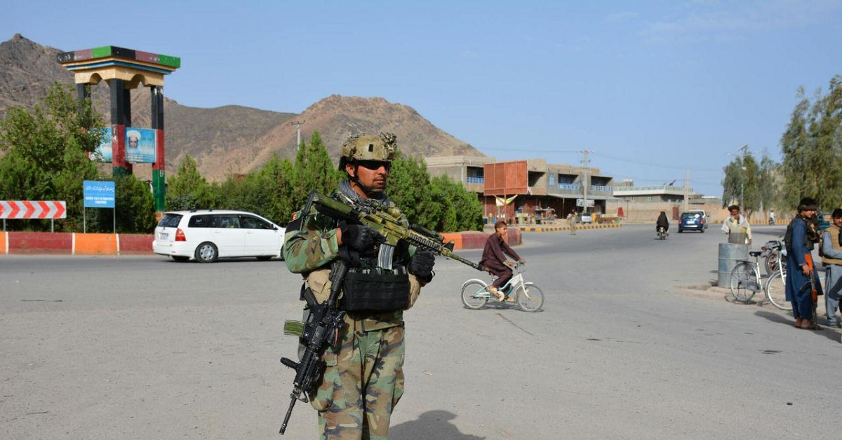An Afghan commando patrols in Farah city after defending the area from a Taliban assault. (DoD)