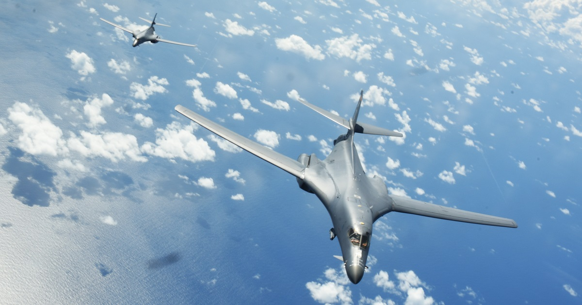 Two Air Force B-1B Lancers fly a 10-hour mission from Andersen Air Force Base, Guam, through the South China Sea, operating with the Navy's Arleigh Burke-class destroyer Sterett on June 8, 2017. The first B-1Bs have resumed flying after a nearly month-long grounding due to problems with the bomber's drogue chute system. (Tech. Sgt. Richard Ebensberger/Air Force)