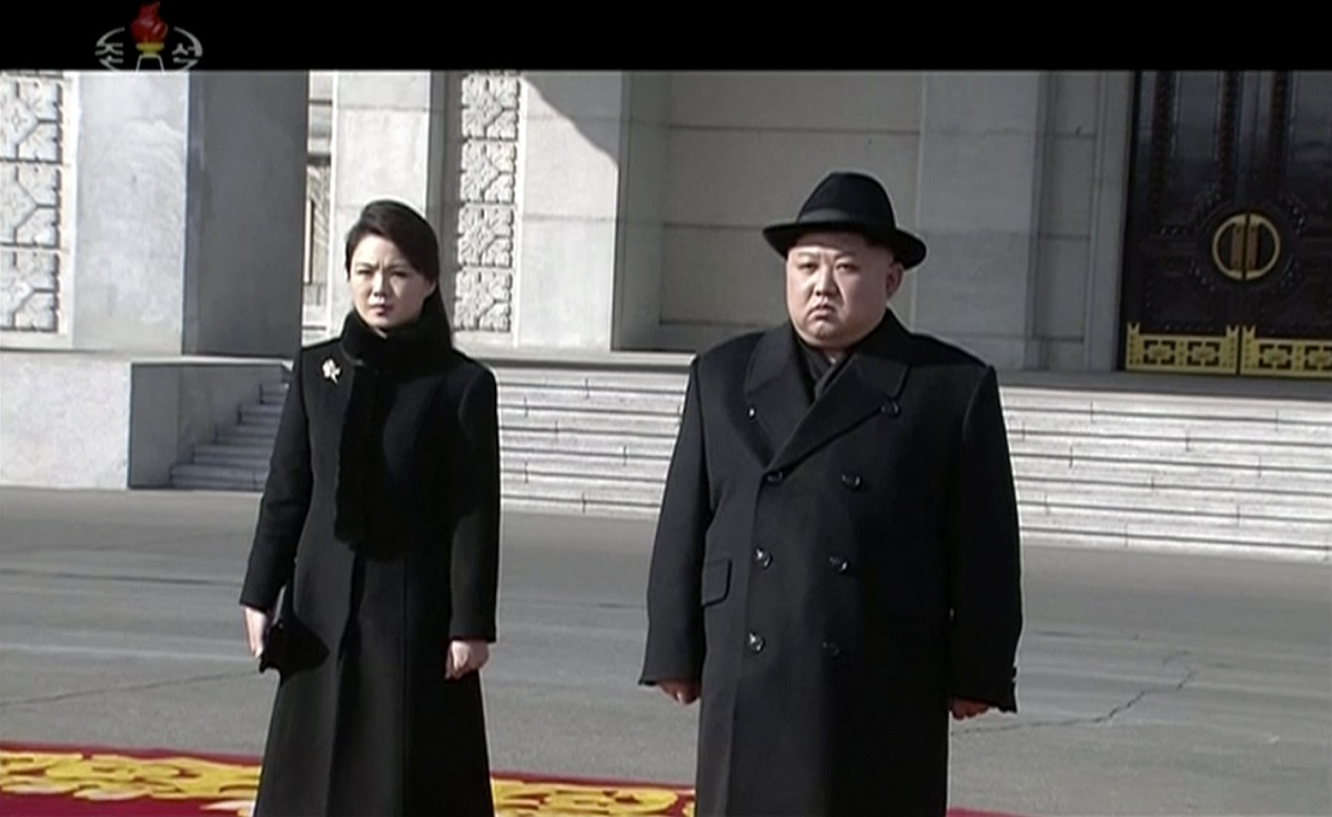 North Korean leader Kim Jong Un, right, and his wife Ri Sol Ju arrive at a military parade in Pyongyang on Feb. 8, 2018. The North held the parade a day before South Korea hosts the opening ceremony for the Winter Olympics in Pyeongchang. (Korean Central Television via AP)