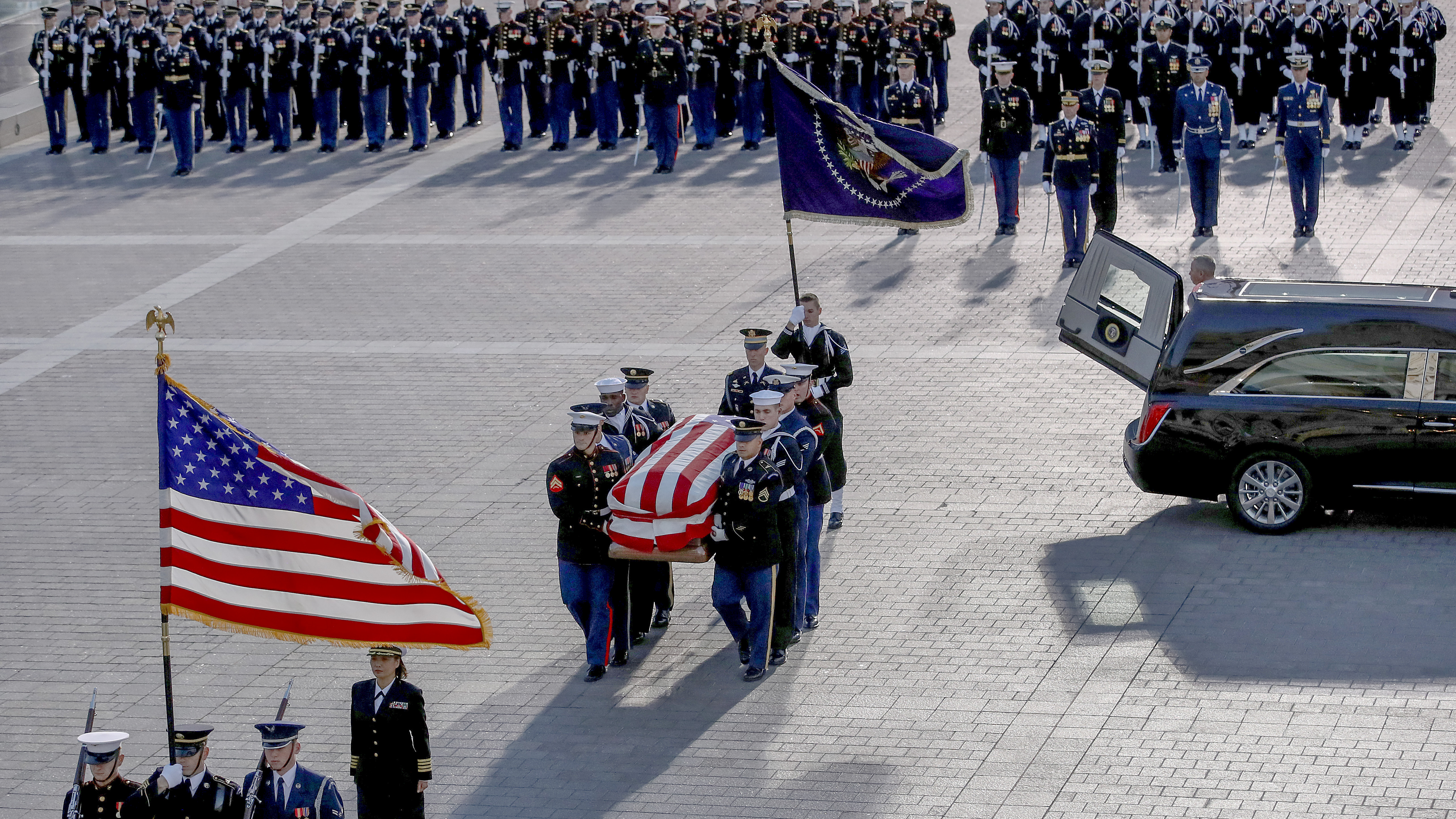A military honor guard team carries the casket of former U.S. President George H. W. Bush into the U.S. Capitol December 3, 2018 in Washington, DC. A state funeral for former U.S. President Bush will be held in Washington over the next three days, beginning with him lying in state in the Rotunda of the Capitol until Wednesday morning. (Photo by Win McNamee/Getty Images)