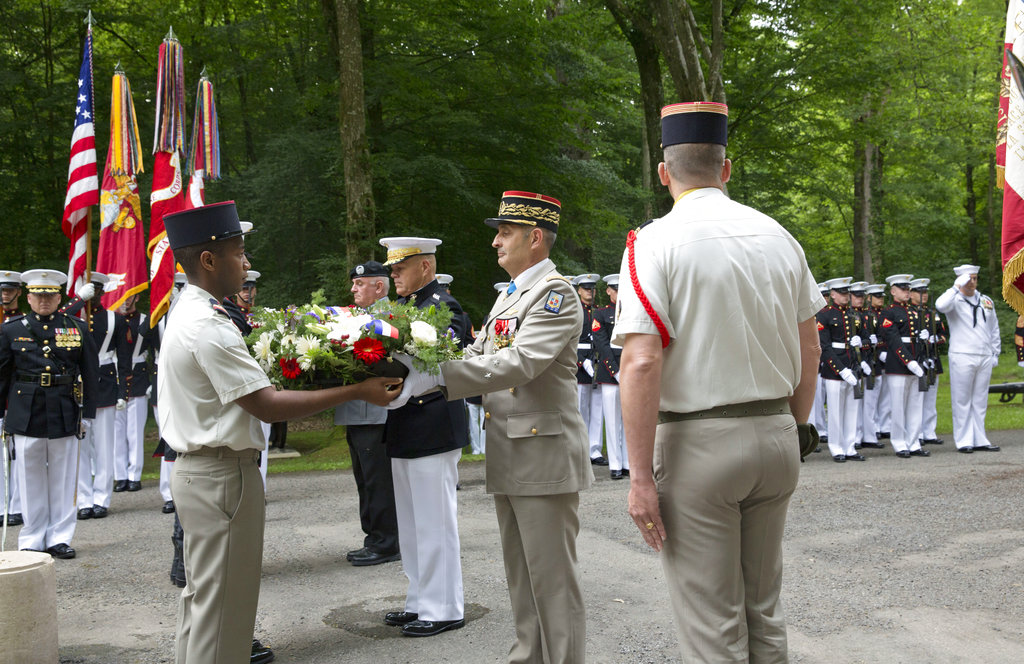 Military representatives from the United States, France and Germany place wreaths at the American Marine Memorial in Belleau Wood prior to a Memorial Day commemoration at the Aisne-Marne American Cemetery in Belleau, France, Sunday, May 27, 2018. (Virginia Mayo/AP)