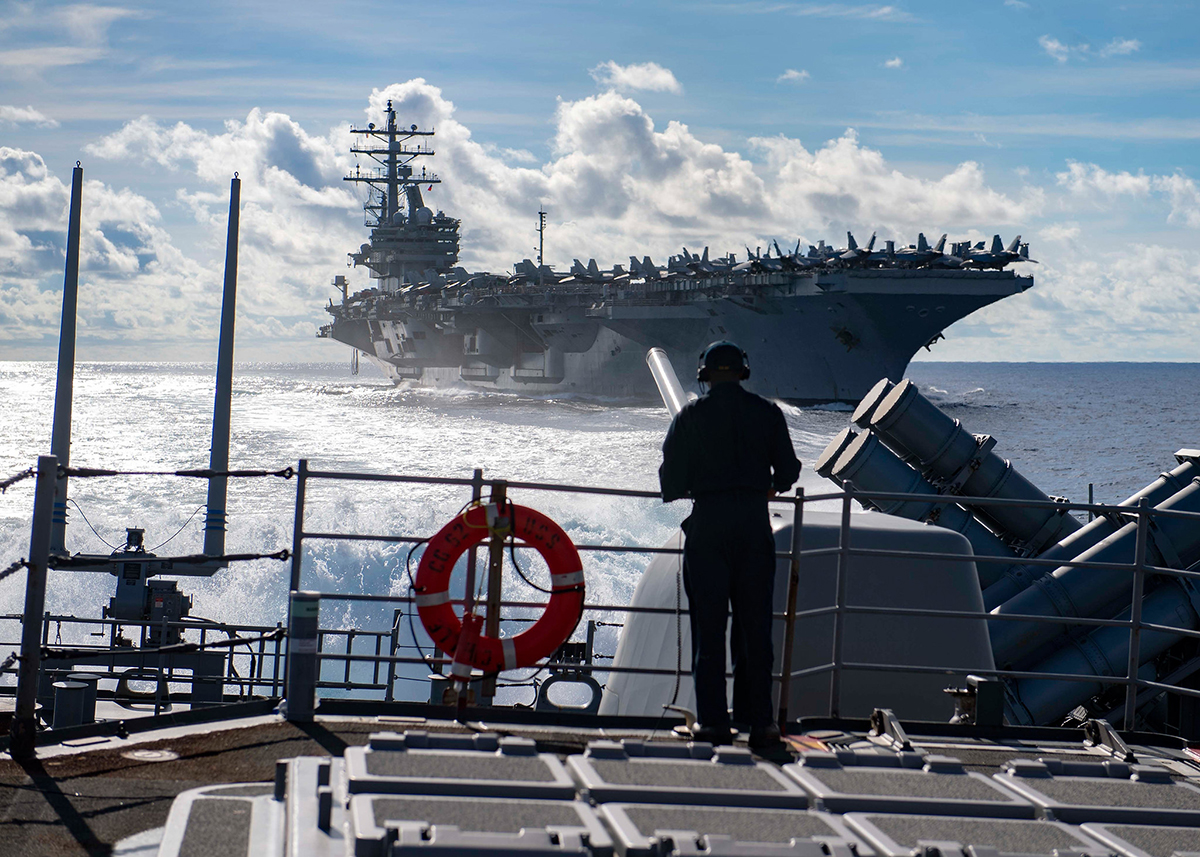 Seaman Marcus White stands watch as aft lookout aboard the Ticonderoga-class guided-missile cruiser USS Chancellorsville (CG 62) on June 30, 2019, during a replenishment-at-sea with the Nimitz-class aircraft carrier USS Ronald Reagan (CVN 76) in the Philippine Sea. (Mass Communication Specialist 2nd Class John Harris/Navy)