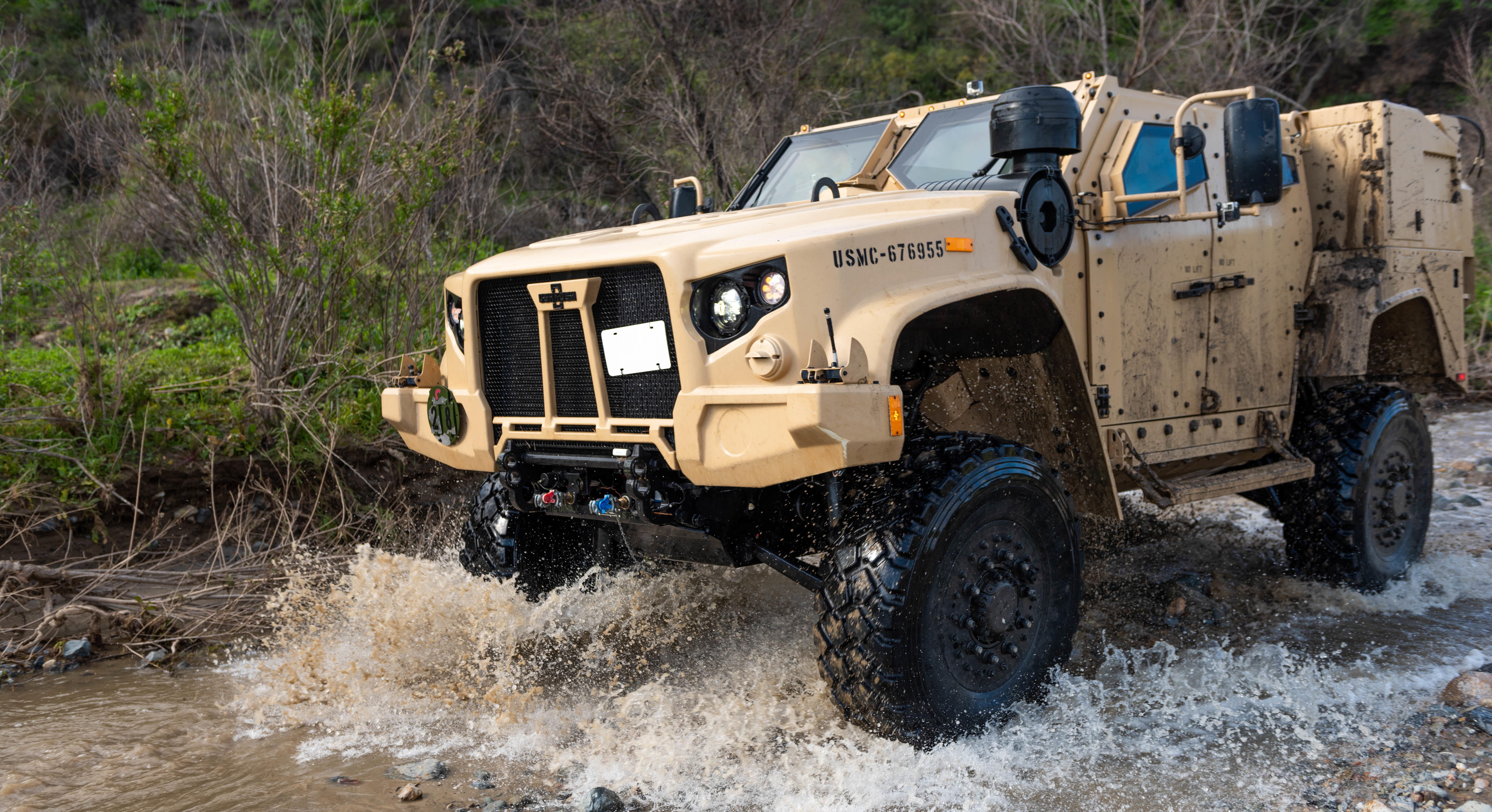 A Joint Light Tactical Vehicle displays its overall capabilities during a live demonstration at the School of Infantry West, Marine Corps Base Camp Pendleton, California. (Sgt. Timothy R. Smithers/Marine Corps)