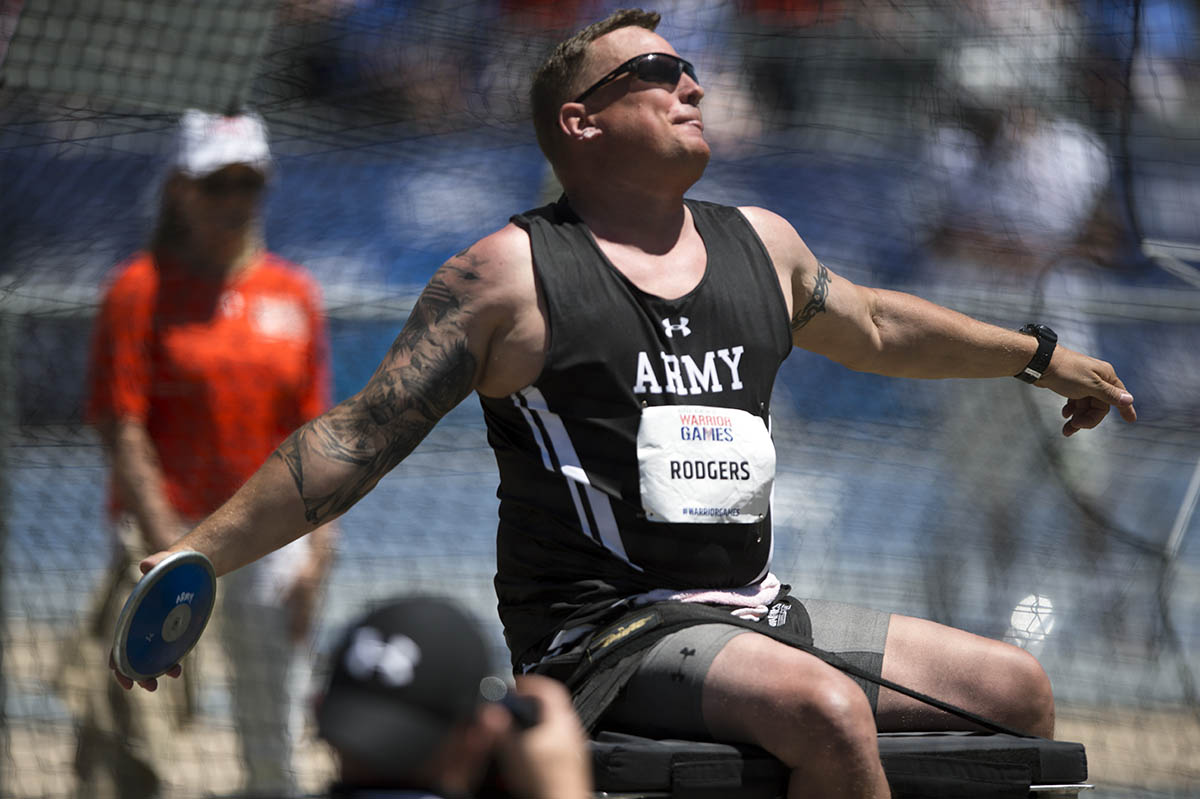Team Army Capt. Kenny Rodgers throws discus in the seated discus competition of the 2018 Warrior Games at the Air Force Academy in Colorado Springs, Colo. June 2, 2018. (EJ Hersom/DoD)