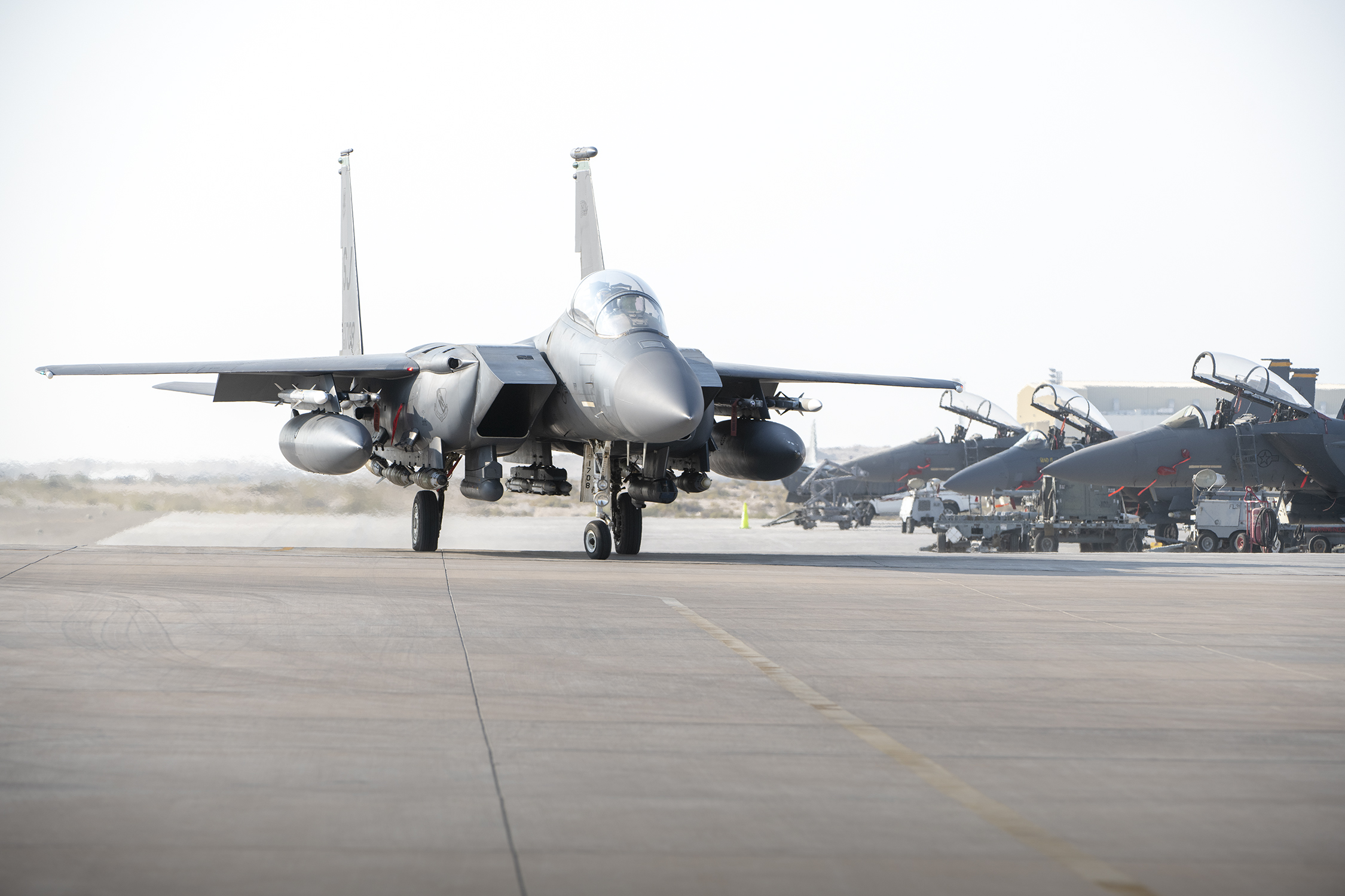"""An F-15E Strike Eagle from the 494th Fighter Squadron taxis to park at Al Dhafra Air Base, United Arab Emirates, Oct. 18. The 494th """"Panthers"""" deployed from the 48th Fighter Wing, RAF Lakenheath, England. (Tech. Sgt. Kat Justen/Air Force)"""