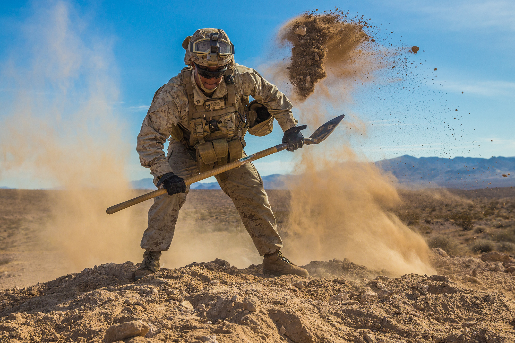Cpl. Rayfel Gonzalez digs an entrenchment for an M240B machine gun Dec. 11, 2019, during exercise Steel Knight 20 (SK20) on Marine Air-Ground Combat Center, Twentynine Palms, Calif. (Cpl. Sabrina Candiaflores/Marine Corps)