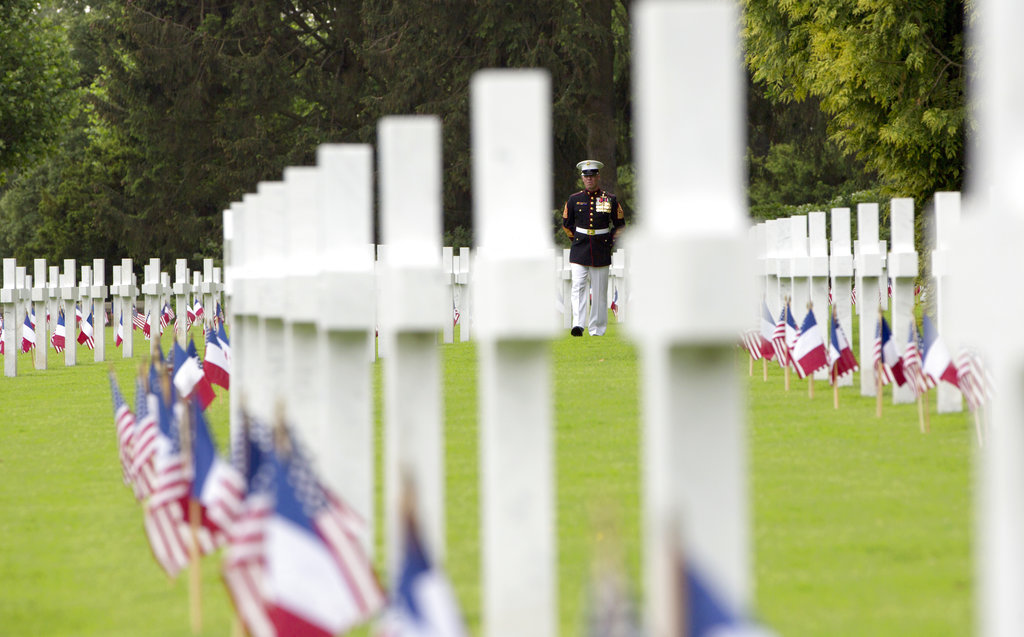 U.S. Marine Corps Sgt. Maj. Darrell Carver walks through the headstones prior to a Memorial Day commemoration at the Aisne-Marne American Cemetery in Belleau, France, Sunday, May 27, 2018. The cemetery contains more that 2,000 American dead. (Virginia Mayo/AP)