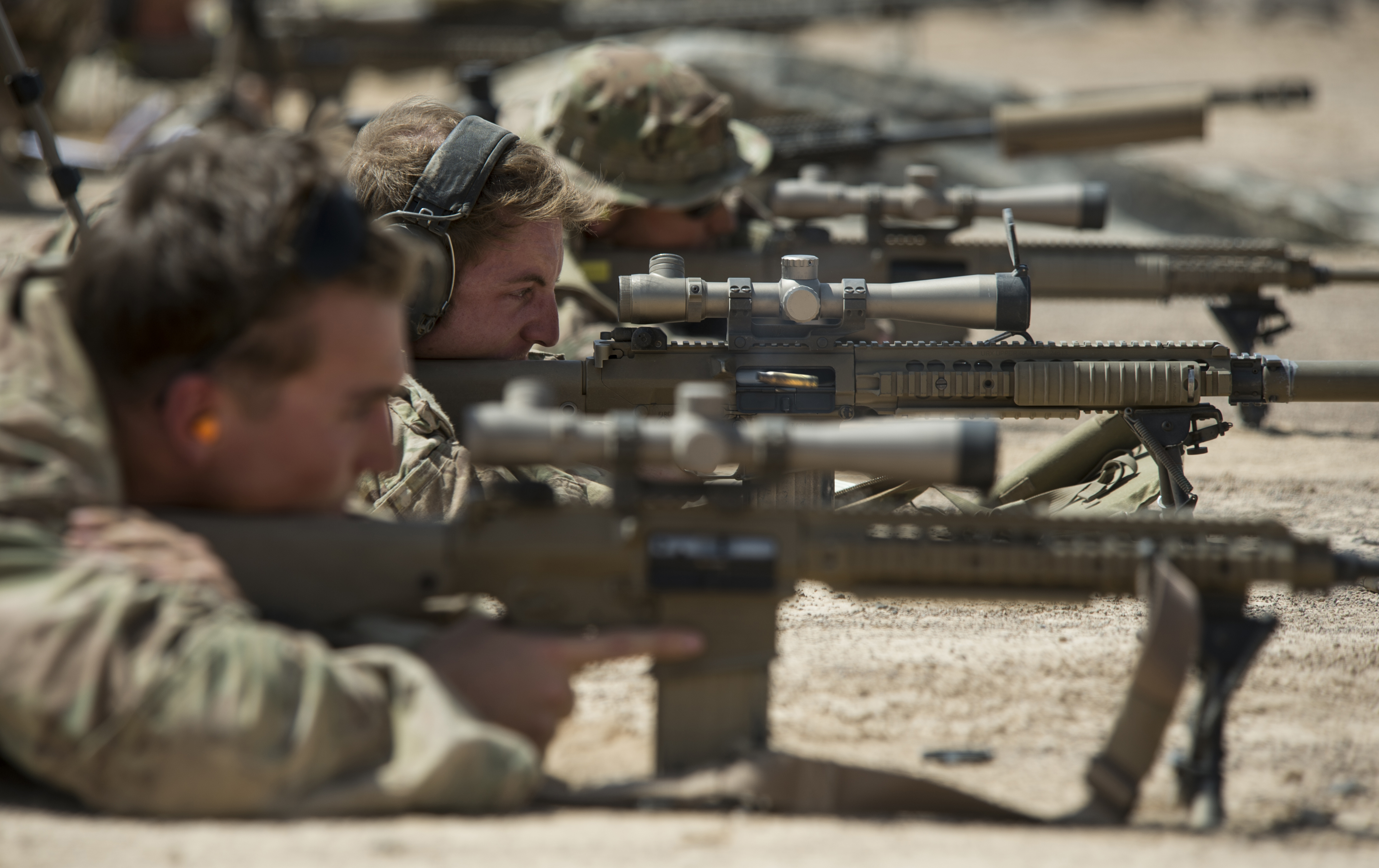 U.S. Army Alpha Company, 3rd Battalion, 15th Infantry Regiment, scout snipers fire M110 sniper rifles on October 14, 2015, in Djibouti. (Senior Airman Peter Thompson/U.S. Air Force)