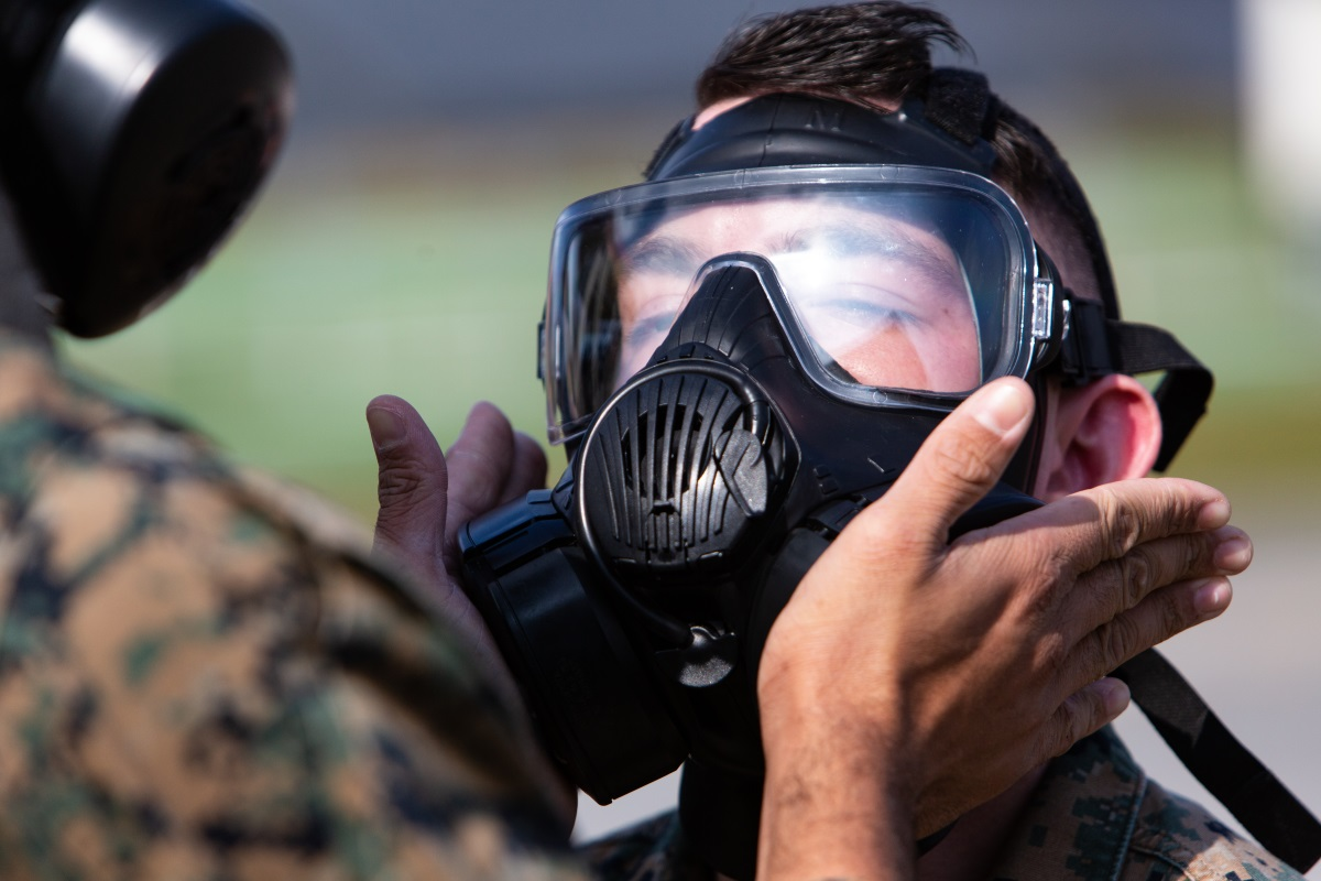 A Marine tests the fit of his M50 Joint Service General Purpose Mask outside the gas chamber at Camp Hansen, Okinawa, Japan, Dec. 19, 2018. (Lance Cpl. Andrew R. Bray/Marine Corps)