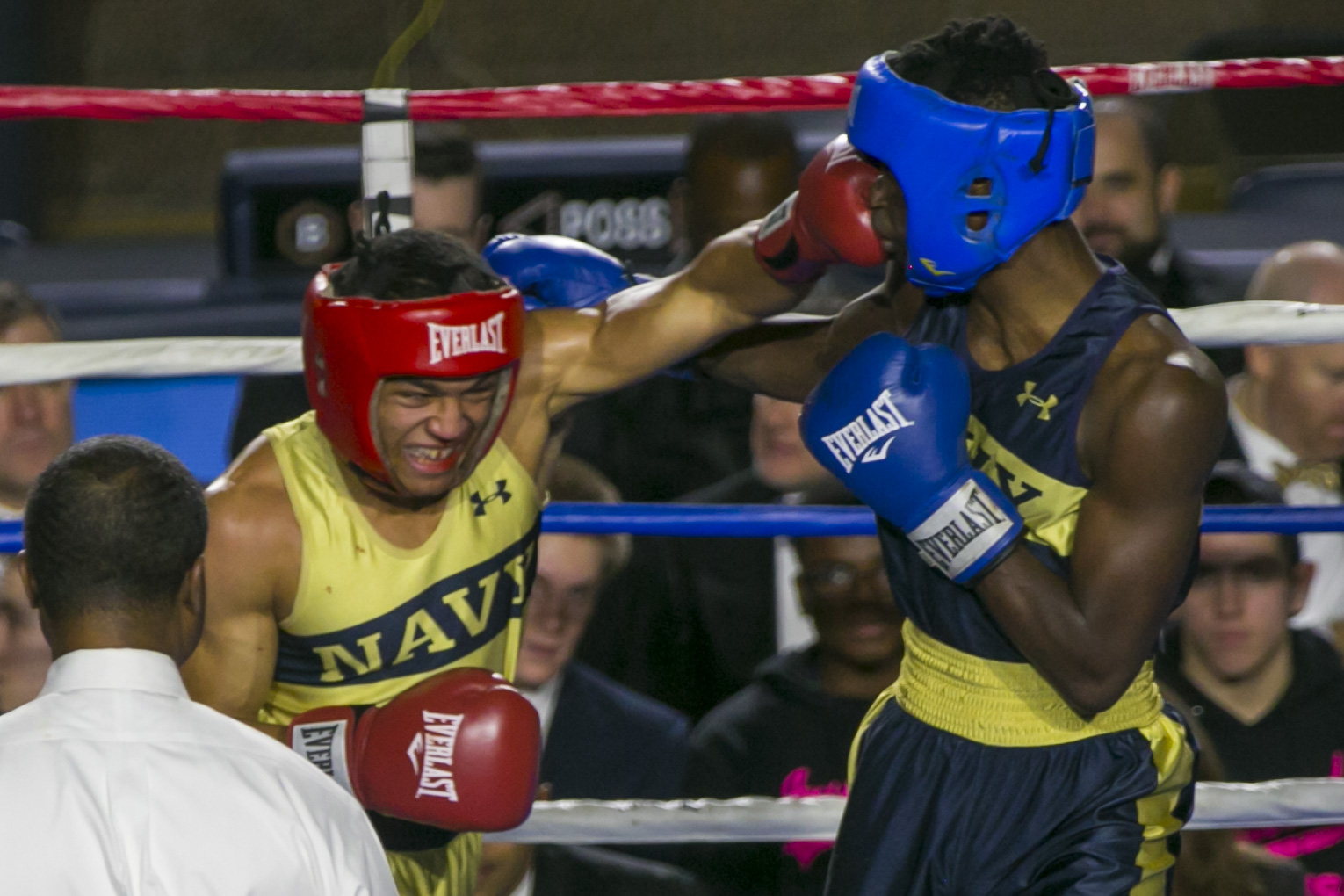 Jordon McDaniel (in gold) from East Chicago, IN, throws a punch into Kendell Louis (in blue) from Miami, FL in the 147-lb weight class bout during the United States Naval Academy's 77th Brigade Boxing Championships held on Feb. 23, 2018. Louis won the fight. (Alan Lessig/Staff)