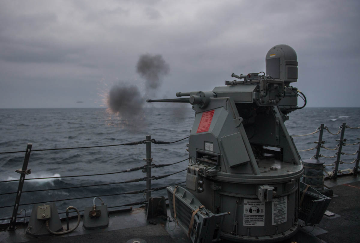 Sailors onboard the guided-missile destroyer Carney fire a Mark 38 25mm machine gun during a live-fire exercise in the Black Sea. (MC2 James R. Turner/Navy)
