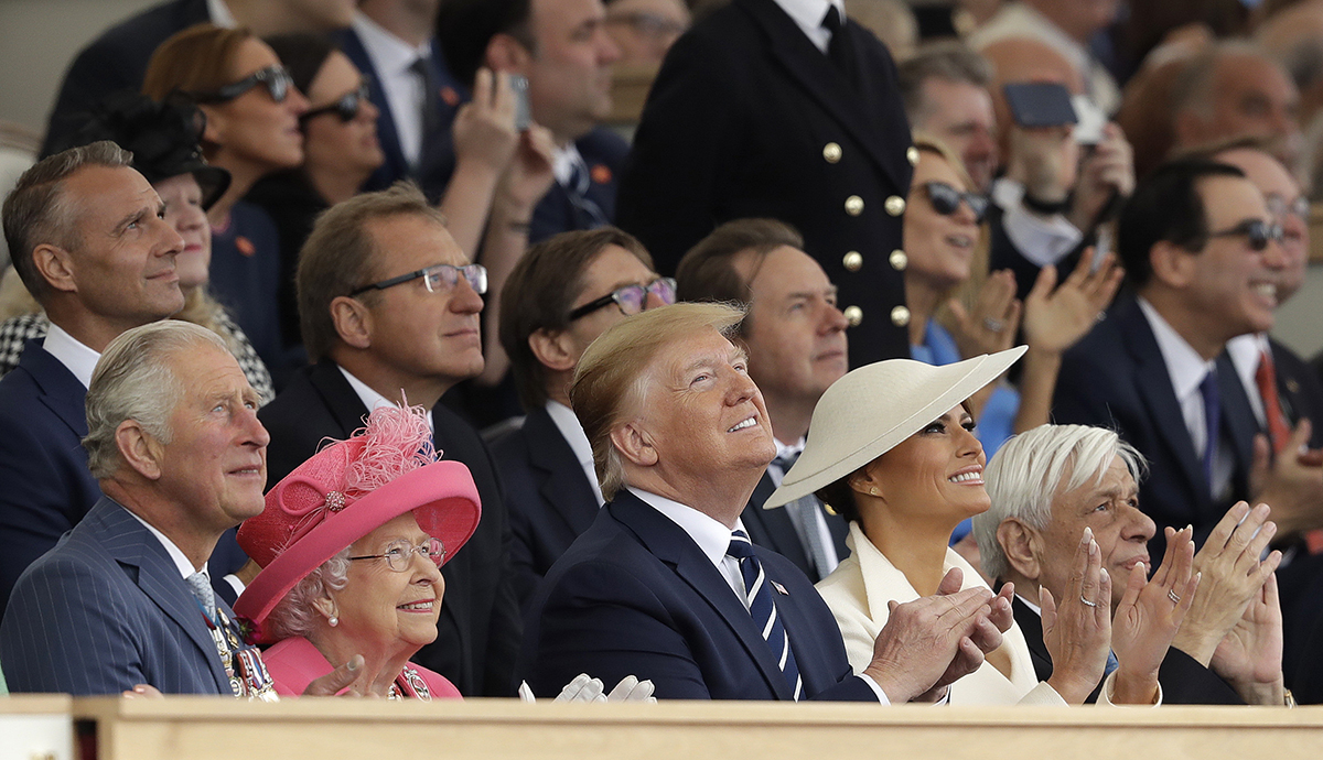 Britain's Prince Charles, Queen Elizabeth II, President Donald Trump, first lady Melania Trump and Greek President Prokopis Pavlopoulos, from left, applaud as they watch a fly past at the end of an event to mark the 75th anniversary of D-Day in Portsmouth, England Wednesday, June 5, 2019. World leaders including U.S. President Donald Trump are gathering Wednesday on the south coast of England to mark the 75th anniversary of the D-Day landings. (Matt Dunham/AP)
