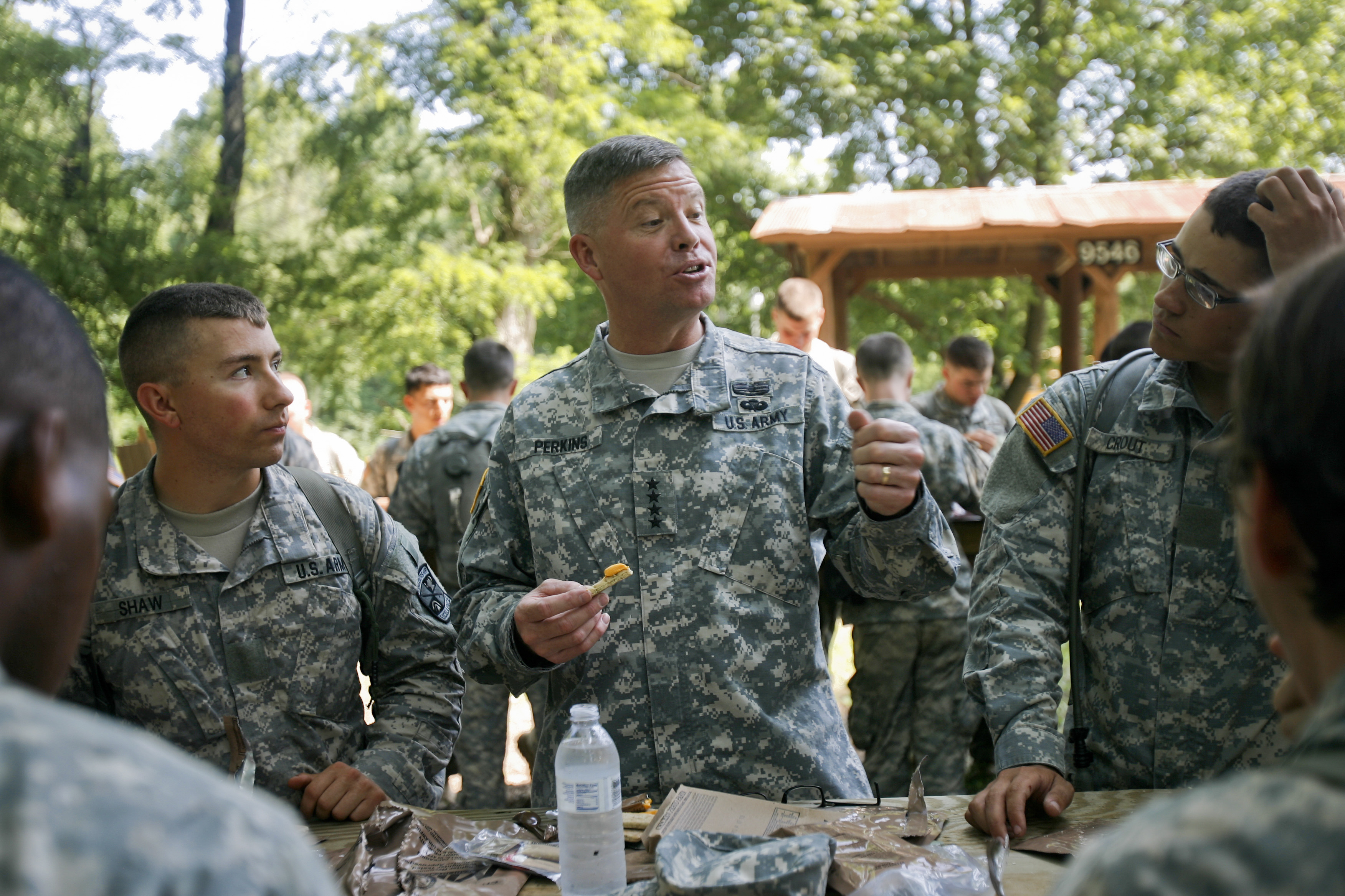 General David Perkins, commanding general, U.S. Army Training and Doctrine Command, visits with cadets during a field exercise July 22, 2014. (Army)