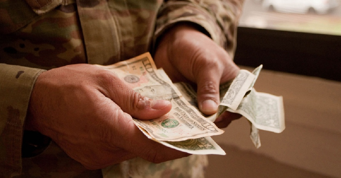 "Thousands of soldiers still must file documents to keep getting the ""with-dependents"" rate or their housing allowance will be reduced. (Kristen Wong/DoD)"