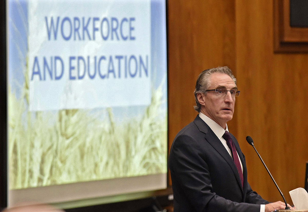 In this Dec. 5, 2018, file photo, Gov. Doug Burgum delivers his budget address before a joint session of the North Dakota legislature in Bismarck, N.D. (Tom Stromme/The Bismarck Tribune via AP)