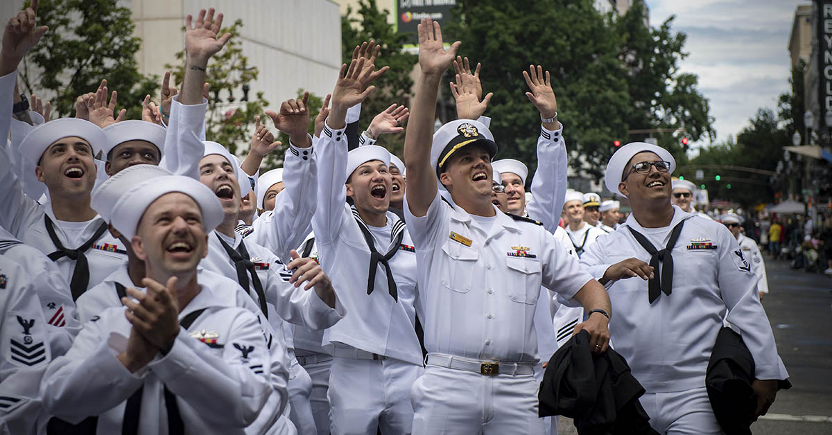 Sailors assigned to Arleigh Burke-class guided-missile destroyer USS Michael Murphy (DDG 112) wave to spectators of the Grand Floral Parade during Portland Rose Festival Fleet Week. (MC2 Ryan J. Batchelder/Navy)