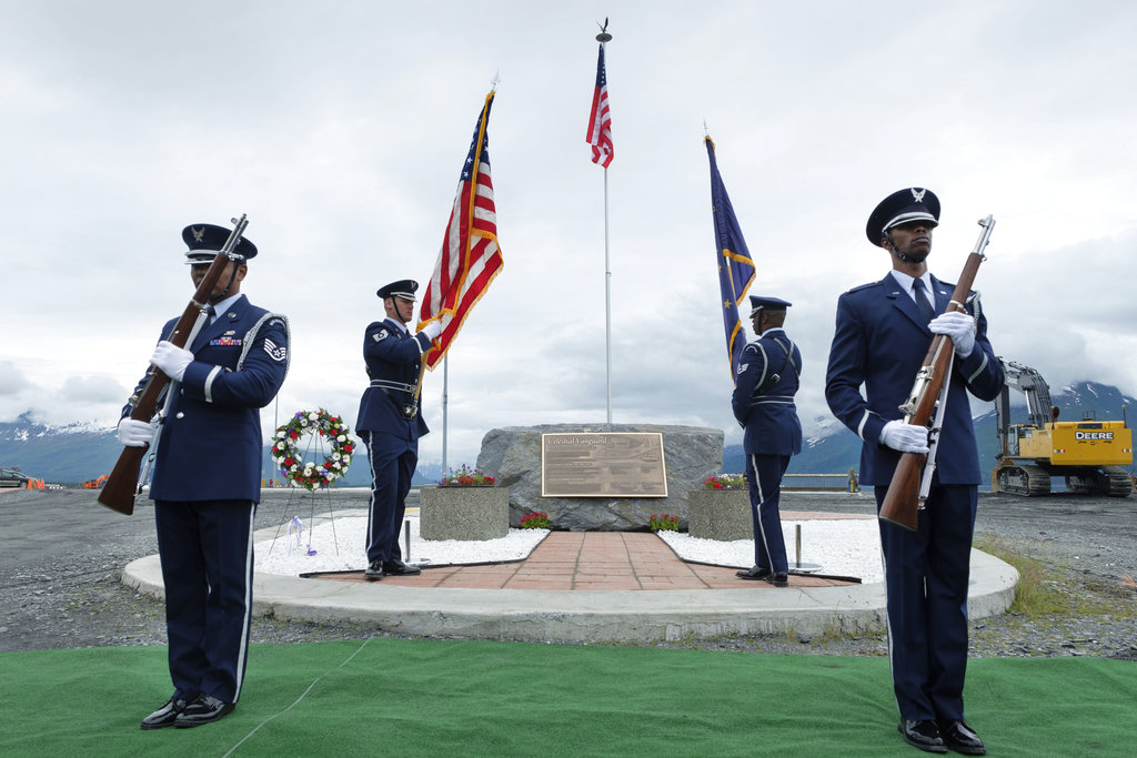 The Alaska Air National Guard honor guard presents colors at a plaque dedication ceremony Saturday, June 23, 2018, in Valdez, Alaska. The memorial plaque honors four Alaska National Guard members killed in April 1964 while conducting a humanitarian mission after the second most powerful earthquake ever destroyed the town. (David Lienemann/Office of Alaska Gov. Bill Walker via AP)