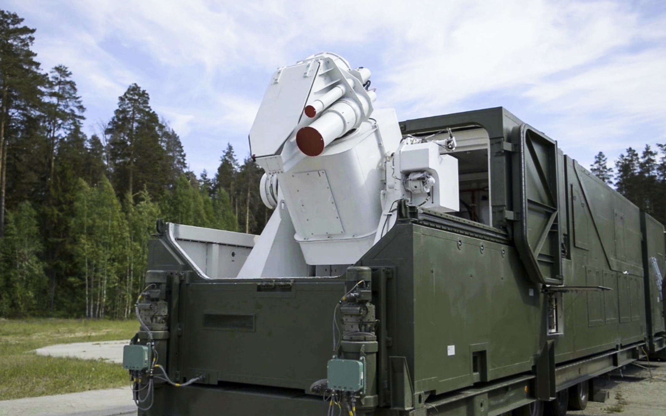 A Russian military truck has a laser weapon mounted on it. (RU-RTR Russian Television via AP)