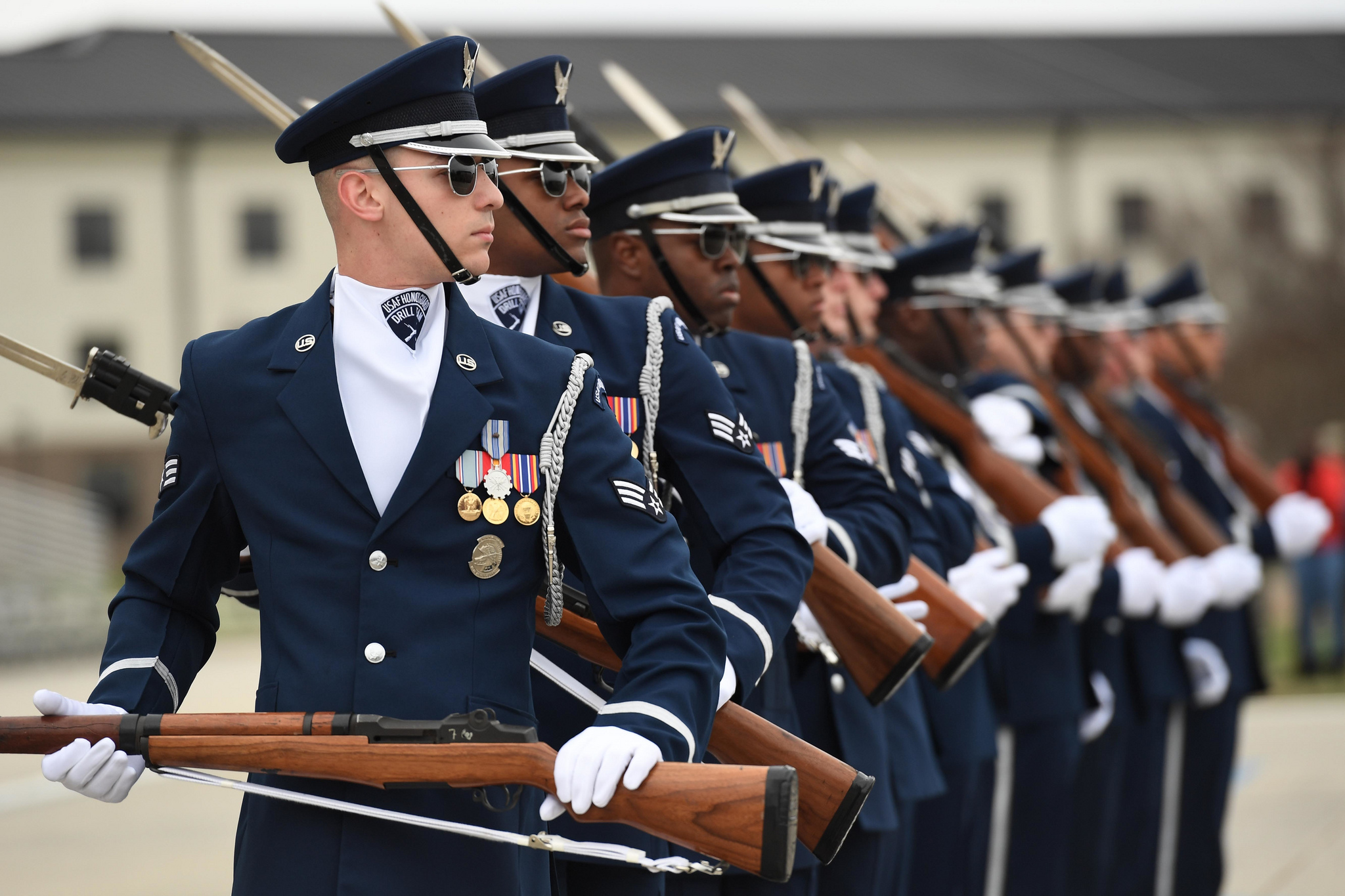 The U.S. Air Force Honor Guard Drill Team debuts their 2019 routine in front of Keesler leadership and 81st Training Group Airmen on the Levitow Training Support Facility drill pad at Keesler Air Force Base, Miss., Feb. 8, 2019. (Kemberly Groue/Air Force)